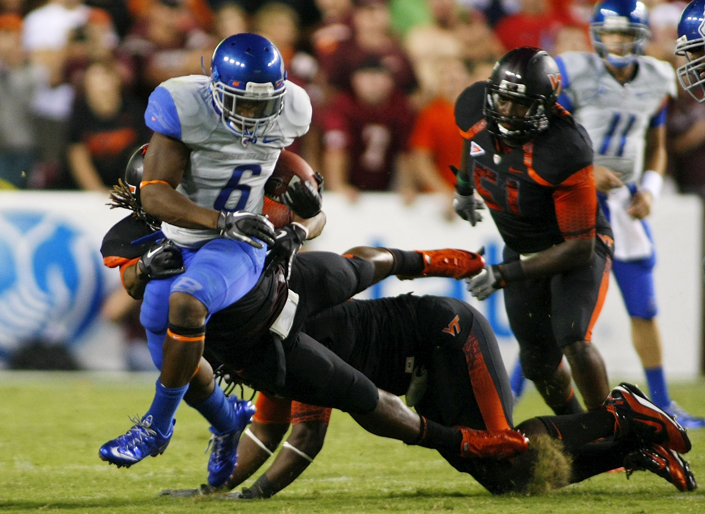 LANDOVER, MD - SEPTEMBER 06:  Running back D.J. Harper #6 of the Boise State Broncos runs with the ball past linebacker Lyndell Gibson #44 of the Virginia Tech Hokies at FedExField on September 6, 2010 in Landover, Maryland.  (Photo by Geoff Burke/Getty I
