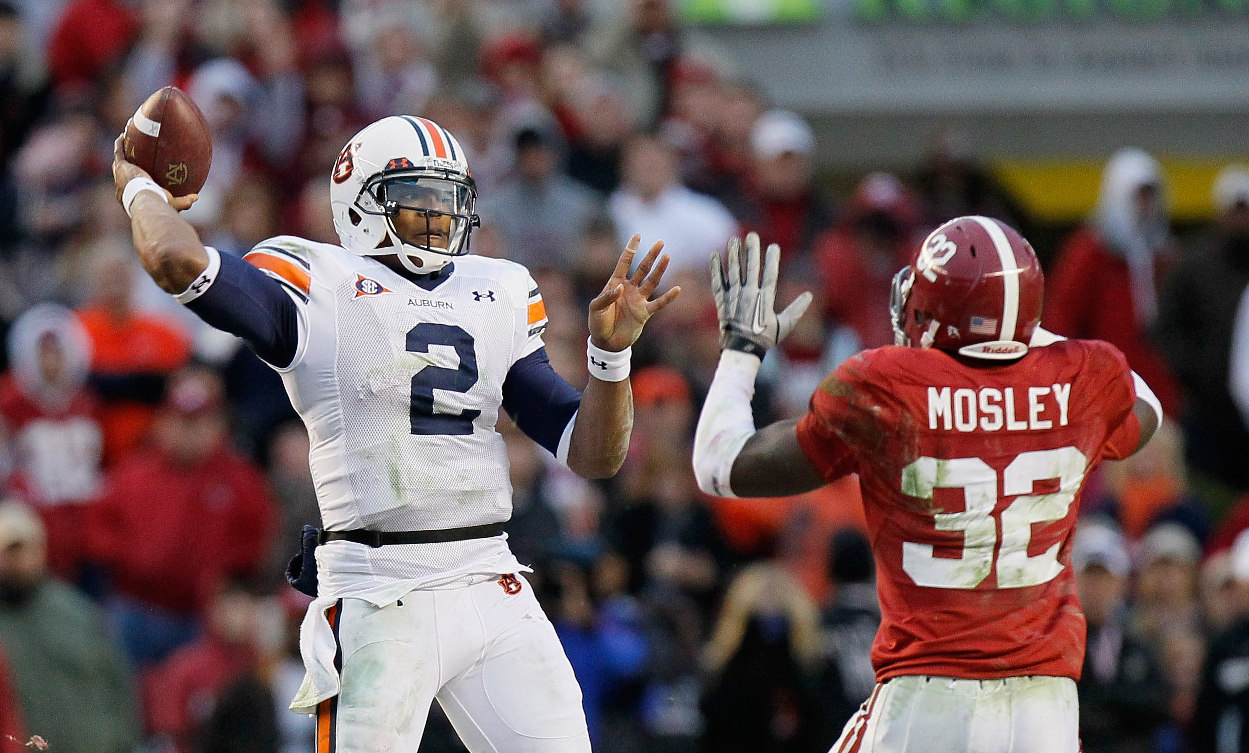 TUSCALOOSA, AL - NOVEMBER 26:  Quarterback Cam Newton #2 of the Auburn Tigers looks to pass against C.J. Mosley #32 of the Alabama Crimson Tide at Bryant-Denny Stadium on November 26, 2010 in Tuscaloosa, Alabama.  (Photo by Kevin C. Cox/Getty Images)