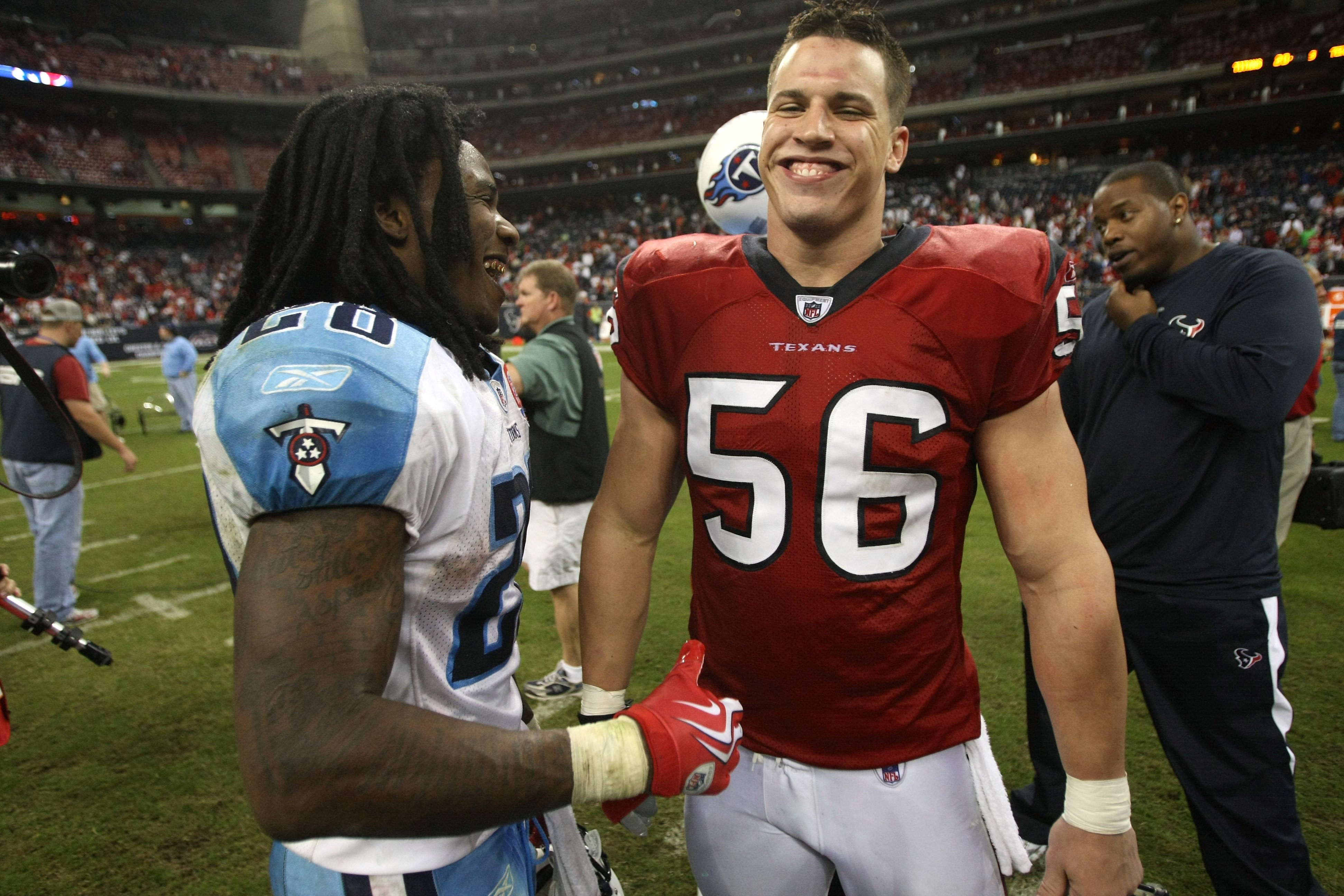 HOUSTON - NOVEMBER 23: Chris Johnson #28 of the Tennessee Titans a nd Brian cushing #56 of the Houston Texans laugh after the game on November 23, 2009  at Reliant Stadium in Houston, Texas.  The Titans won 20-17.  (Photo by Stephen Dunn/Getty Images)