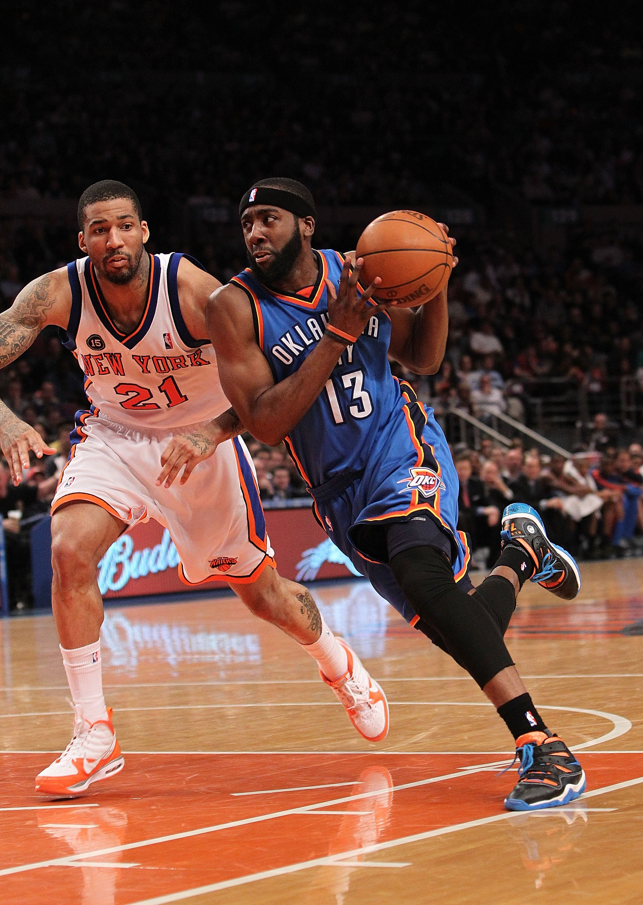 NEW YORK - FEBRUARY 20:  James Harden #13 of the Oklahoma City Thunder drives to the basket against Wilson Chandler #21 of the New York Knicks at Madison Square Garden on February 20, 2010 in New York, New York. NOTE TO USER: User expressly acknowledges a