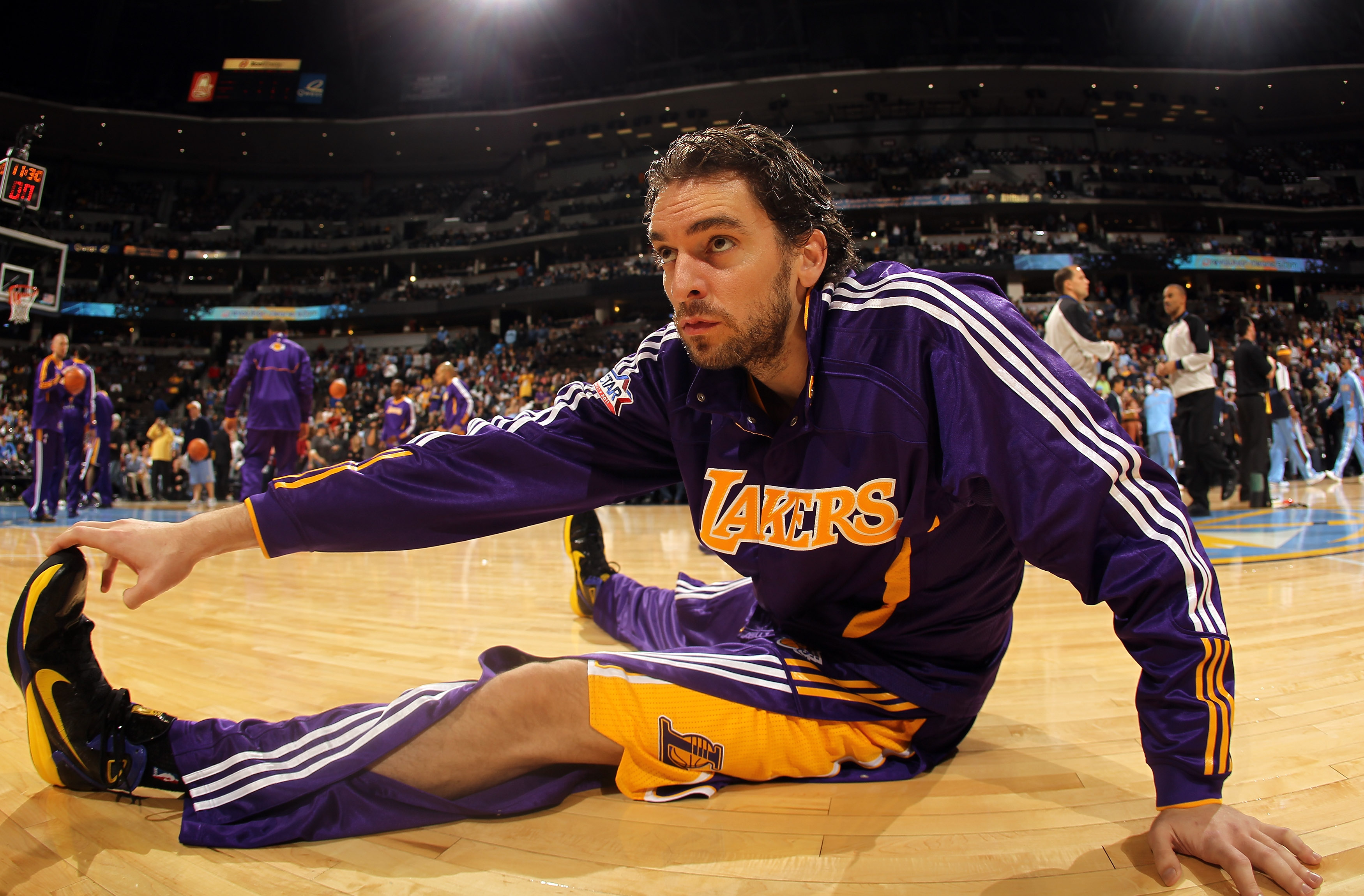 DENVER - NOVEMBER 11:  Pau Gasol #16 of the Los Angeles Lakers stretches prior to facing the Denver Nuggets at the Pepsi Center on November 11, 2010 in Denver, Colorado. The Nuggets defeated the Lakers 118-112.  NOTE TO USER: User expressly acknowledges a