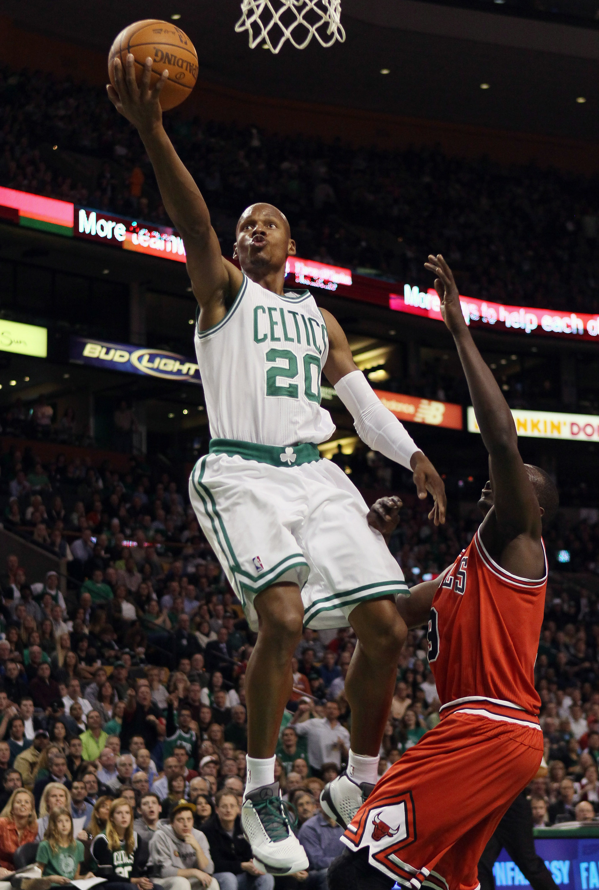 BOSTON, MA - NOVEMBER 05:  Ray Allen #20 of the Boston Celtics takes a shot as Luol Deng #9 of the Chicago Bulls defends on November 5, 2010 at the TD Garden in Boston, Massachusetts.  NOTE TO USER: User expressly acknowledges and agrees that, by download