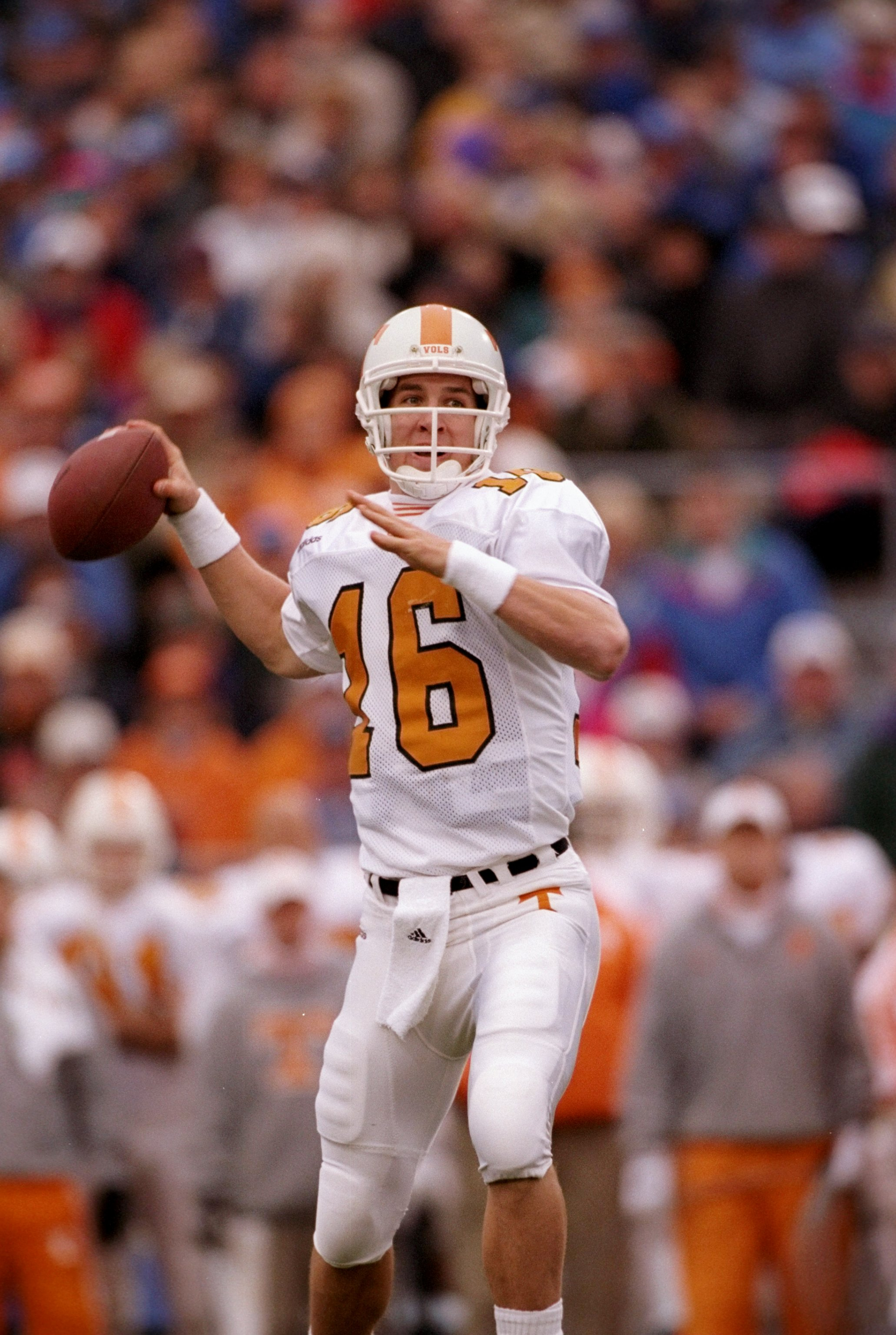 23 Nov 1997:  Quarterback Peyton Manning of the Tennessee Volunteers drops back to pass during a game against the Kentucky Wildcats at Commonwealth Stadium in Lexington, Kentucky.  Tennessee won the game 59-31. Mandatory Credit: Rick Stewart  /Allsport
