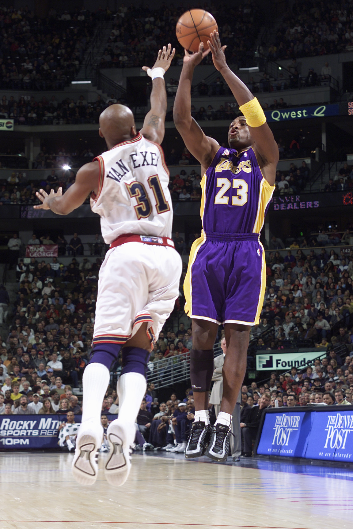 21 Nov 2001:  Guard Mitch Richmond #23 of the Los Angeles Lakers gets a clean shot off against Nick Van Exel #31 of the Denver Nuggets in the first half at the Pepsi Center in Denver, Colorado.  Richmond had two points off the bench in the first half.