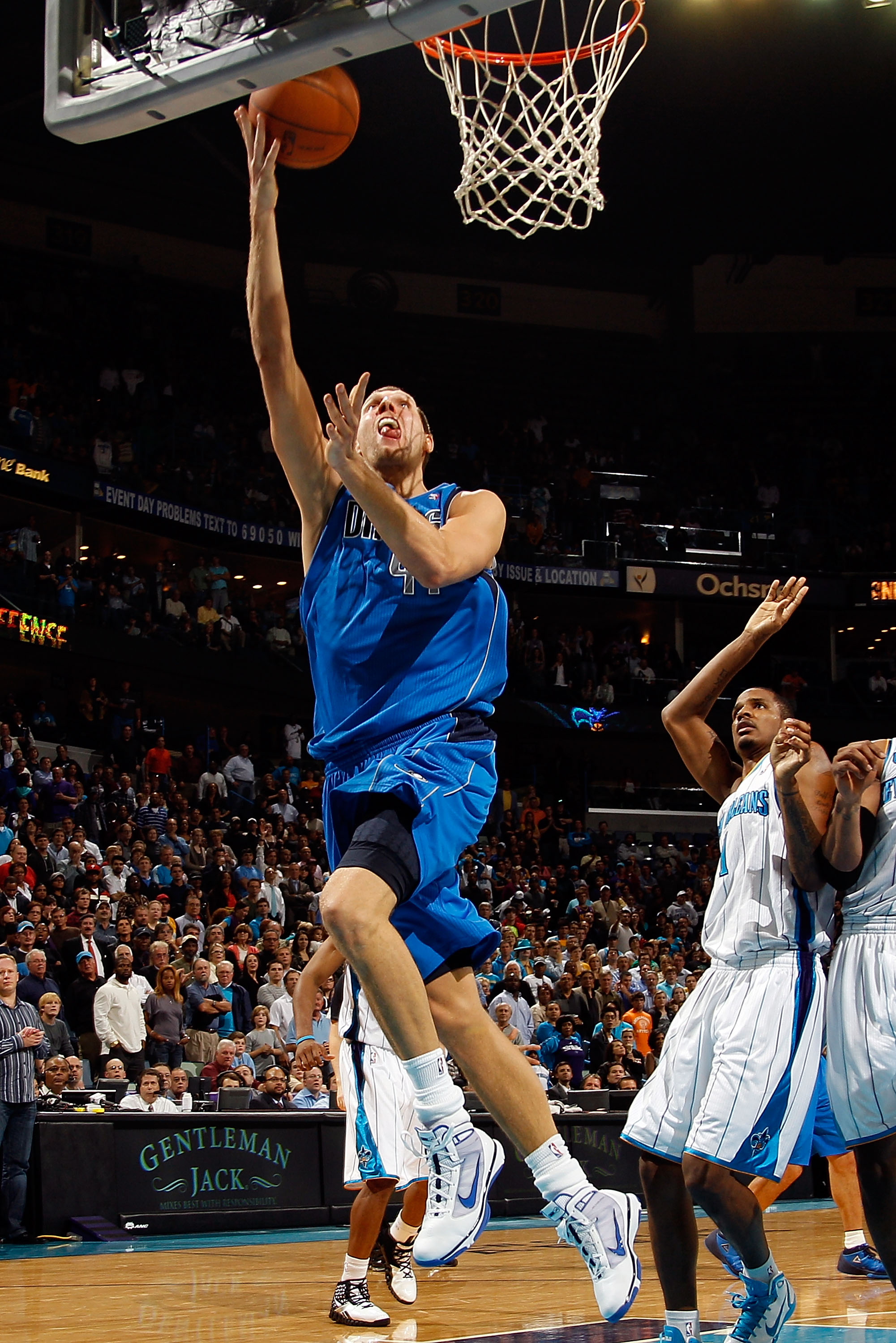 NEW ORLEANS - NOVEMBER 17:  Dirk Nowitzki #41 of Germany of the Dallas Mavericks shoots the ball over Trevor Ariza #1 of the New Orleans Hornets at the New Orleans Arena on November 17, 2010 in New Orleans, Louisiana.  The Hornets defeated the Mavericks 9