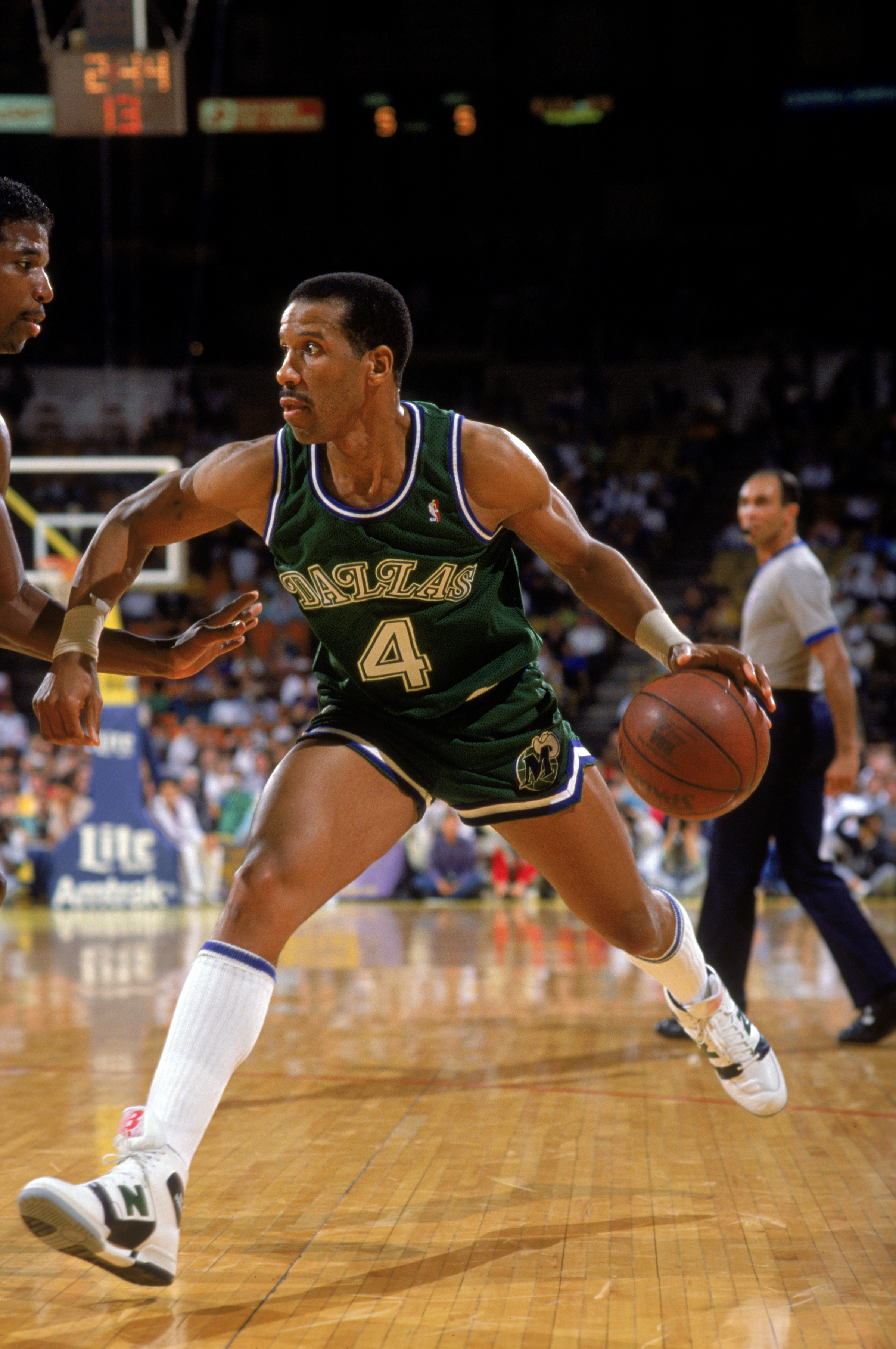 LOS ANGELES - 1988:  Adrian Dantley #4 of the Dallas Mavericks drives the ball during the NBA game against the Los Angeles Lakers at the Great Western Forum in Los Angeles, California in 1988.  (Photo by Scott Halleran/Getty Images)