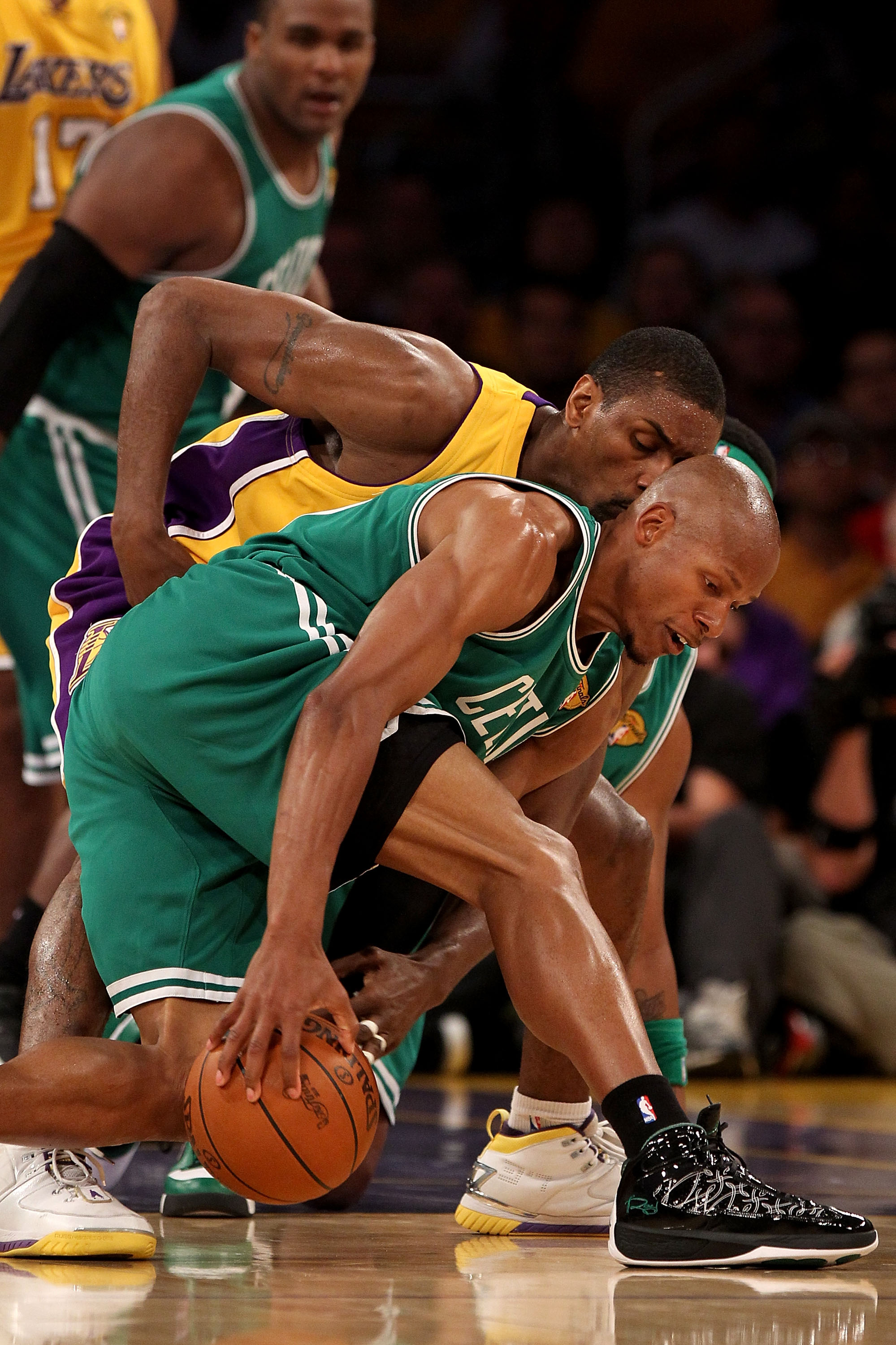LOS ANGELES, CA - JUNE 17:  Ray Allen #20 of the Boston Celtics tries to hold on to the ball under pressure from Ron Artest #37 of the Los Angeles Lakers in Game Seven of the 2010 NBA Finals at Staples Center on June 17, 2010 in Los Angeles, California.