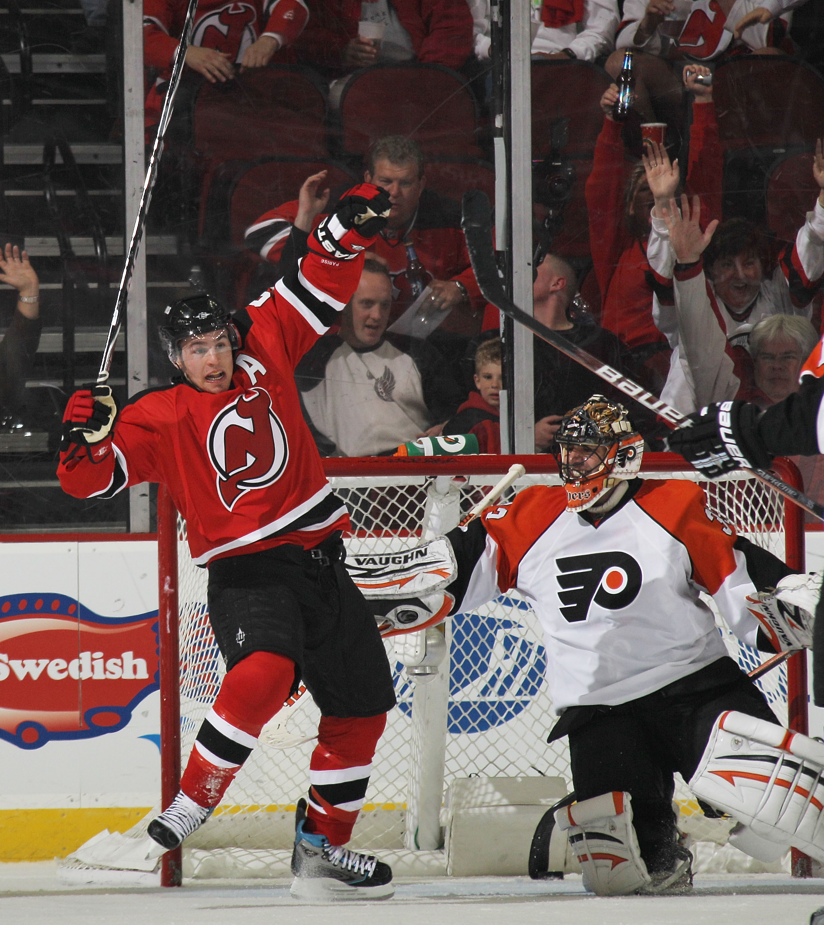 NEWARK, NJ - APRIL 14: Zach Parise #9 of the New Jersey Devils celebrates a goal by Travis Zajac #19 (not shown) against Brian Boucher #33 of the Philadelphia Flyers in Game One of the Eastern Conference Quarterfinals during the 2010 NHL Stanley Cup Playo