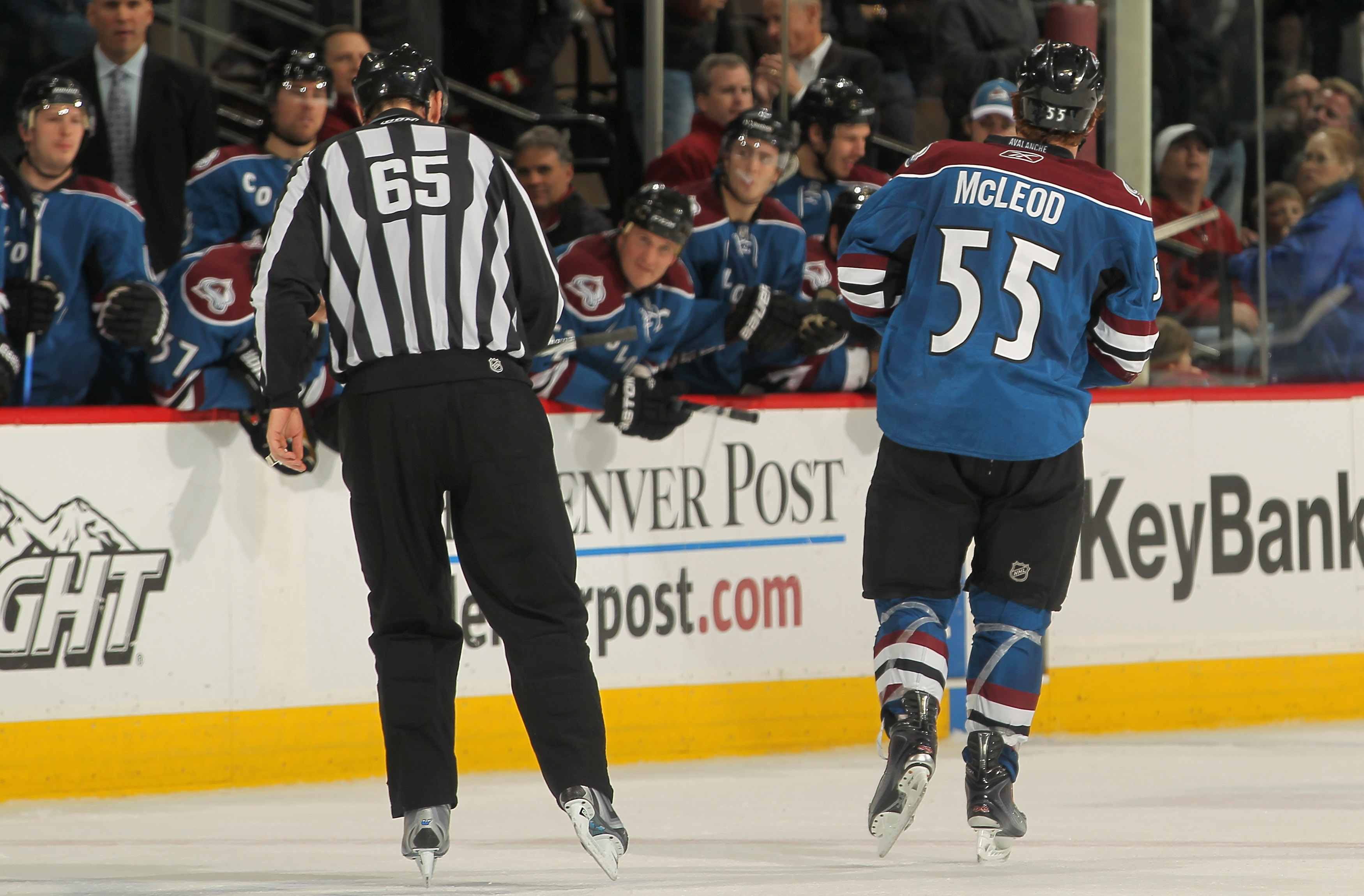 DENVER - NOVEMBER 19:  Cody McLeod #55 of the Colorado Avalanche is sent off the ice as he and Sean Avery #16 of the New York Rangers recieving misconduct penalties late in the third period at the Pepsi Center on November 19, 2010 in Denver, Colorado. The