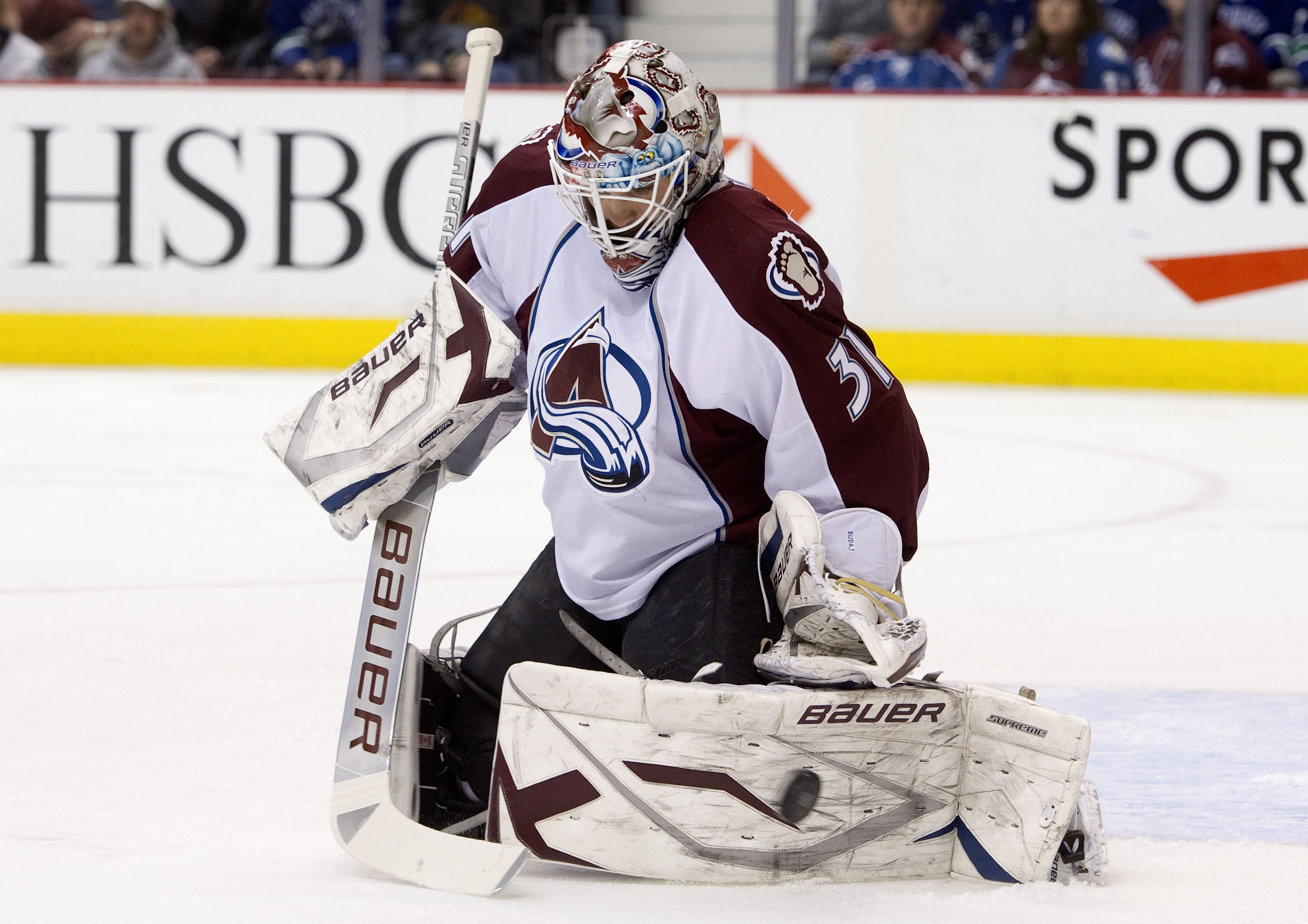VANCOUVER, CANADA - NOVEMBER 24: Goalie Peter Budaj #31 of the Colorado Avalanche makes a pad save against the Vancouver Canucks during the second period in NHL action on November 24, 2010 at Rogers Arena in Vancouver, British Columbia, Canada.  (Photo by