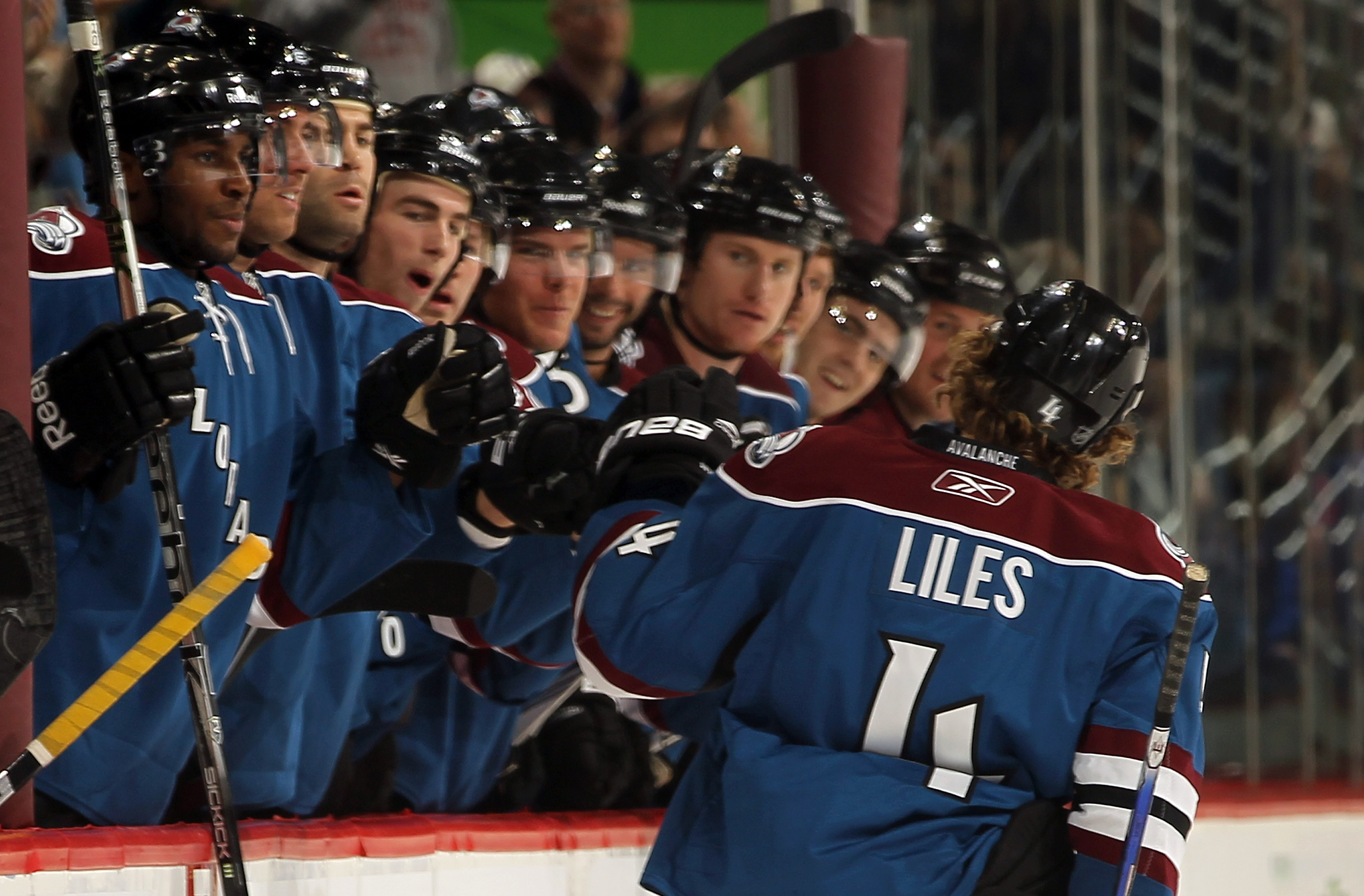 DENVER - NOVEMBER 15:  Defenseman John-Michael Liles #4 of the Colorado Avalanche is congratulated for his goal against the St. Louis Blues at the Pepsi Center on November 15, 2010 in Denver, Colorado. Liles had two goals as the Avalanche defeated the Blu