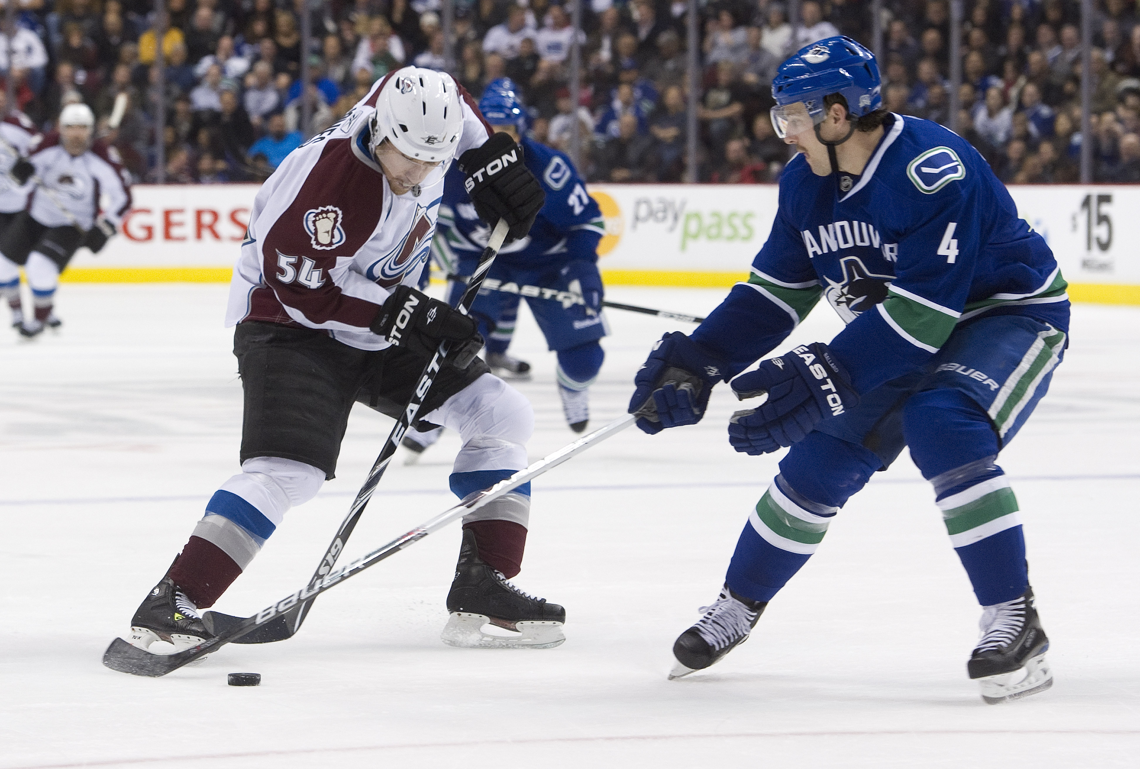 VANCOUVER, CANADA - NOVEMBER 24: David Jones #54 of the Colorado Avalanche tries to makes a move to get past Keith Ballard #4 of the Vancouver Canucks during the third period in NHL action on November 24, 2010 at Rogers Arena in Vancouver, British Columbi