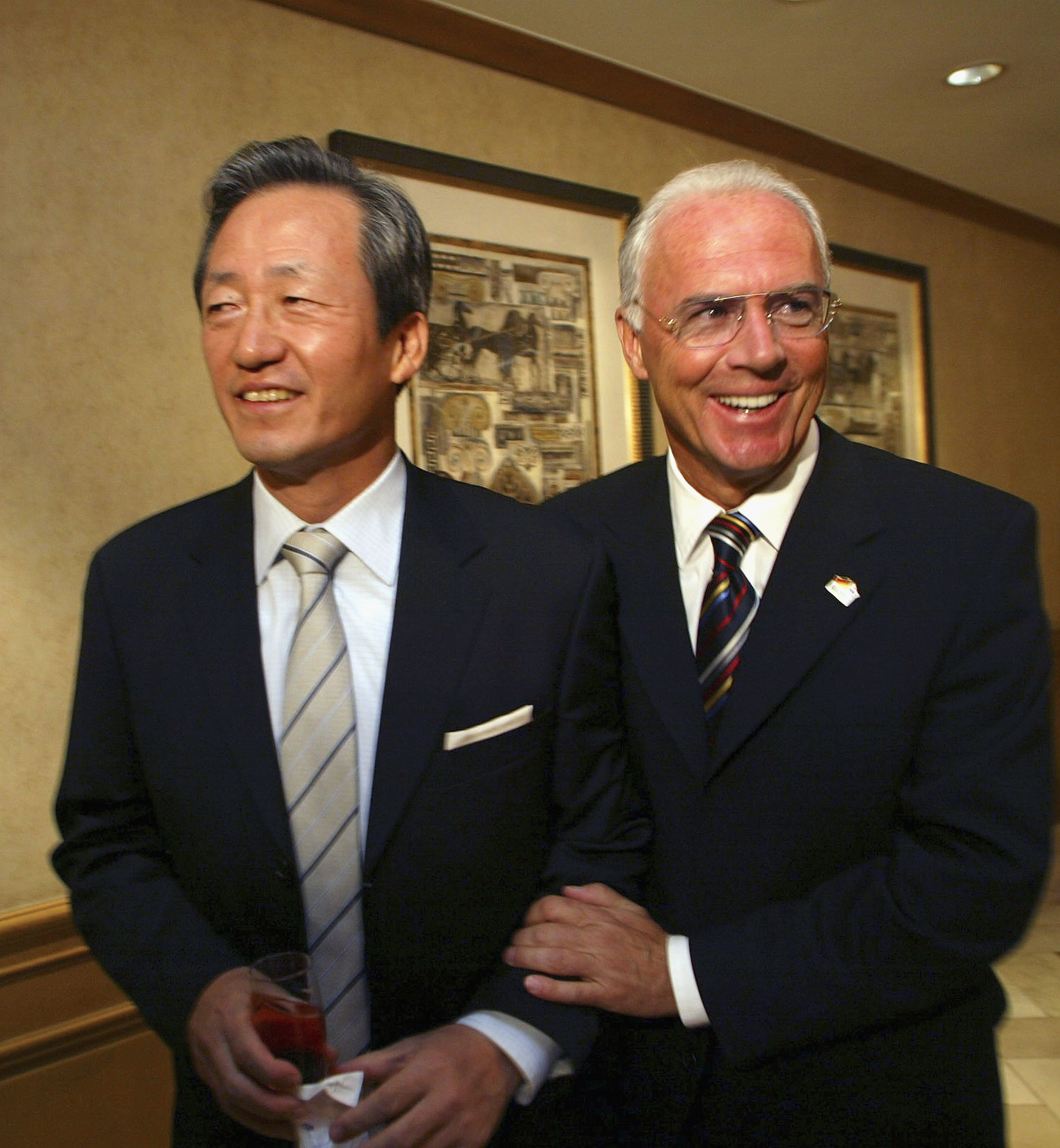 SEOUL, SOUTH KOREA - OCTOBER 5: Franz Beckenbauer (R), president of the 2006 Football World Cup organizing committee, jokes with Chung Mong-Joon, president of KFA (Korea Football Association) before a presentation session for 2006 Football World Cup on Oc