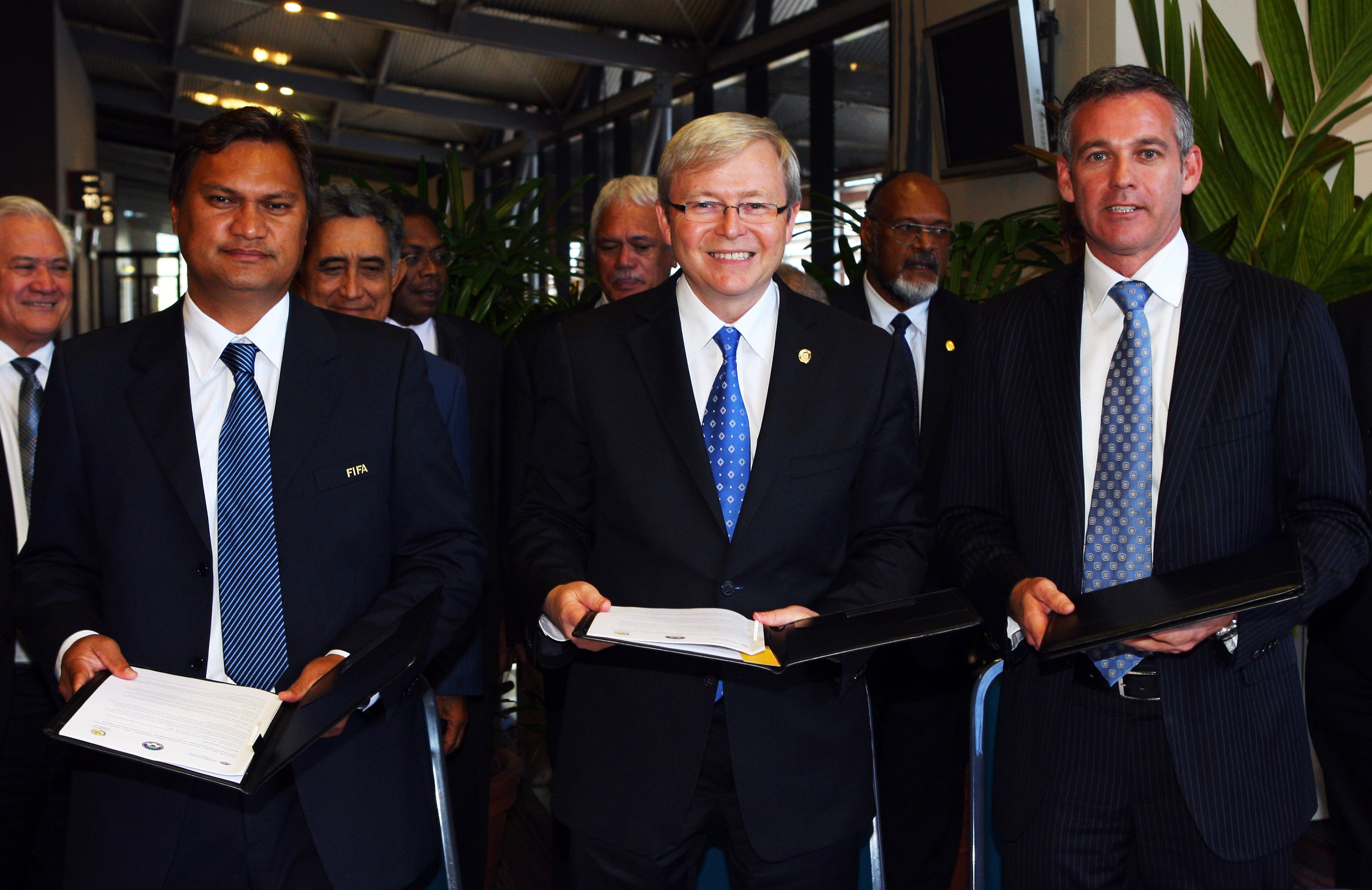CAIRNS, AUSTRALIA - AUGUST 05:  (L-R) President of the Oceania Football Confederation Reynald Temarii, Australian Prime Minister Kevin Rudd and CEO of Football Australia Ben Buckley pose after signing an agreement at the Pacific Island Leaders Forum in th