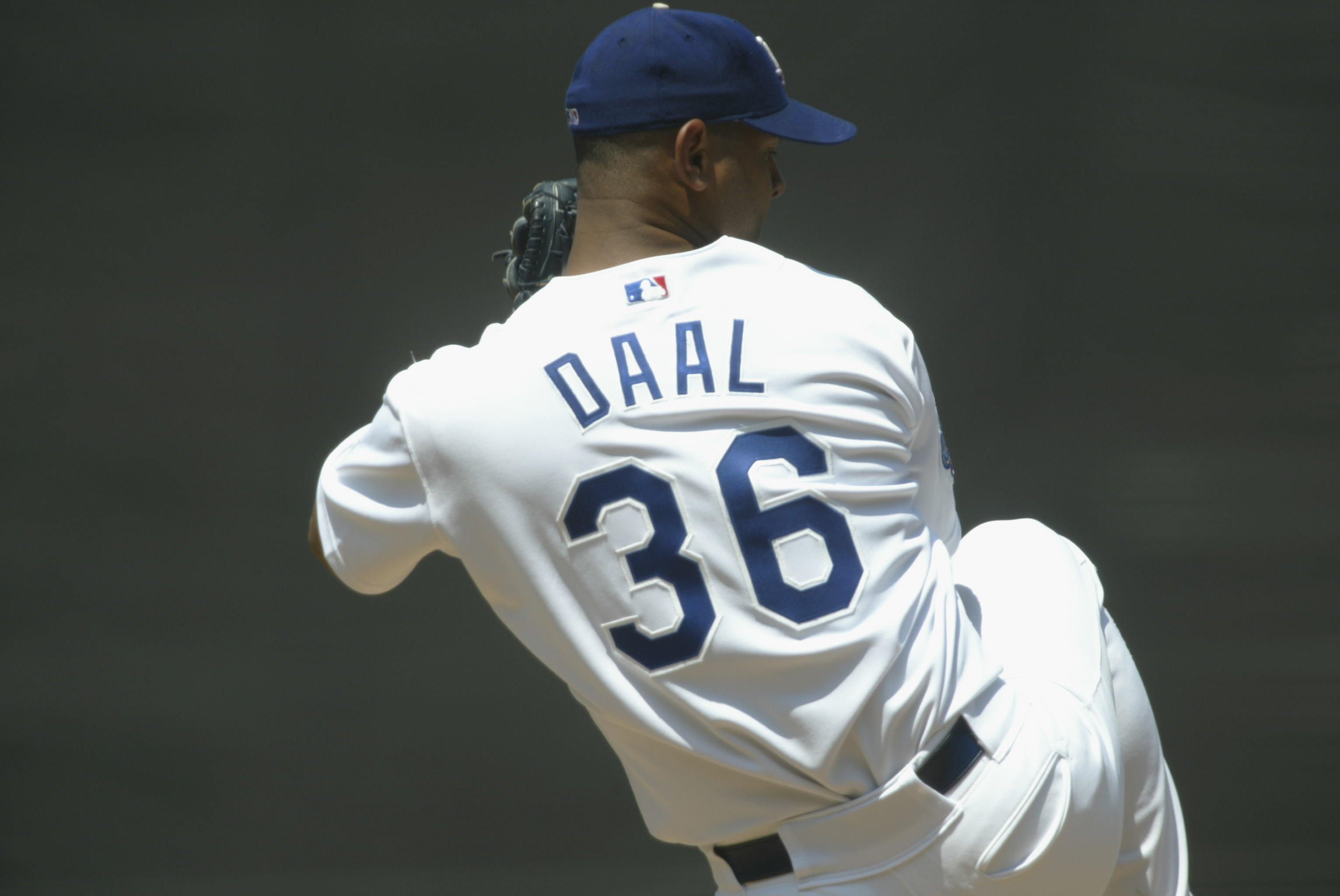 LOS ANGELES - JULY 20:  Starting Pitcher Omar Daal #36 of the Los Angeles Dodgers throws against the San Francisco Giants during the MLB game on July 20, 2002 at Dodger Stadium in Los Angeles, California.  The Dodgers defeated the Giants 4-2.  (Photo by S