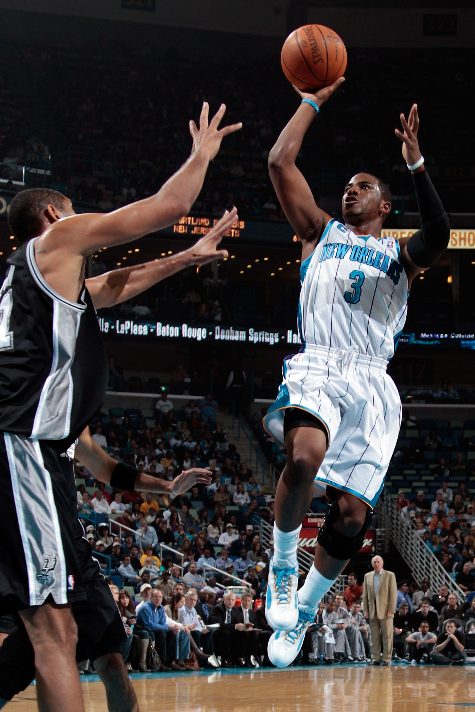 NEW ORLEANS - NOVEMBER 28:  Chris Paul #3 of the New Orleans Hornets shoots the ball over Tim Duncan #21 of the San Antonio Spurs at the New Orleans Arena on November 28, 2010 in New Orleans, Louisiana.  NOTE TO USER: User expressly acknowledges and agree