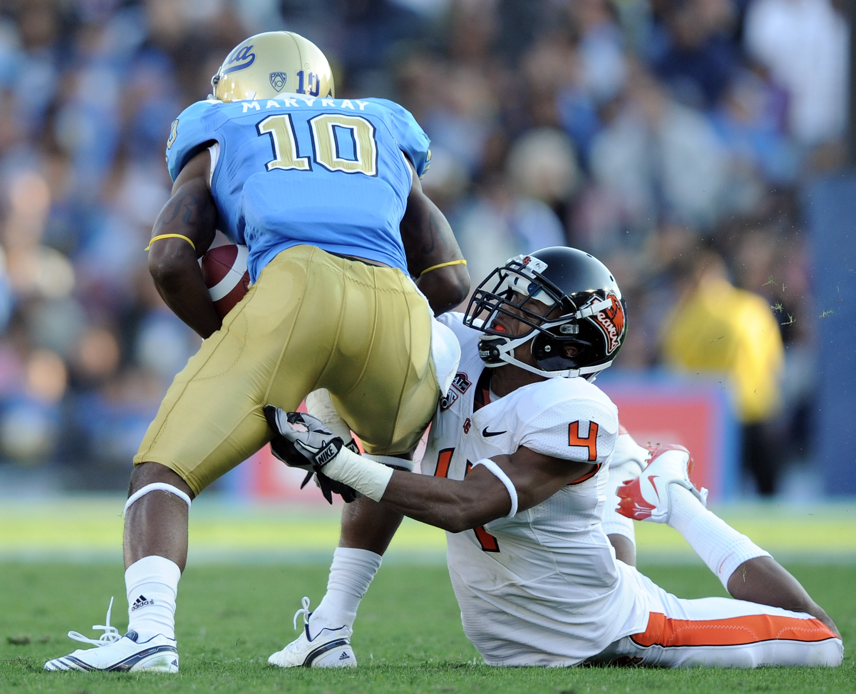 PASADENA, CA - NOVEMBER 06:  James Dockery #4 of the Oregon State Beavers attempts to tackle Akeem Ayers #10 of the UCLA Bruins after a catch at the Rose Bowl on November 6, 2010 in Pasadena, California.  (Photo by Harry How/Getty Images)