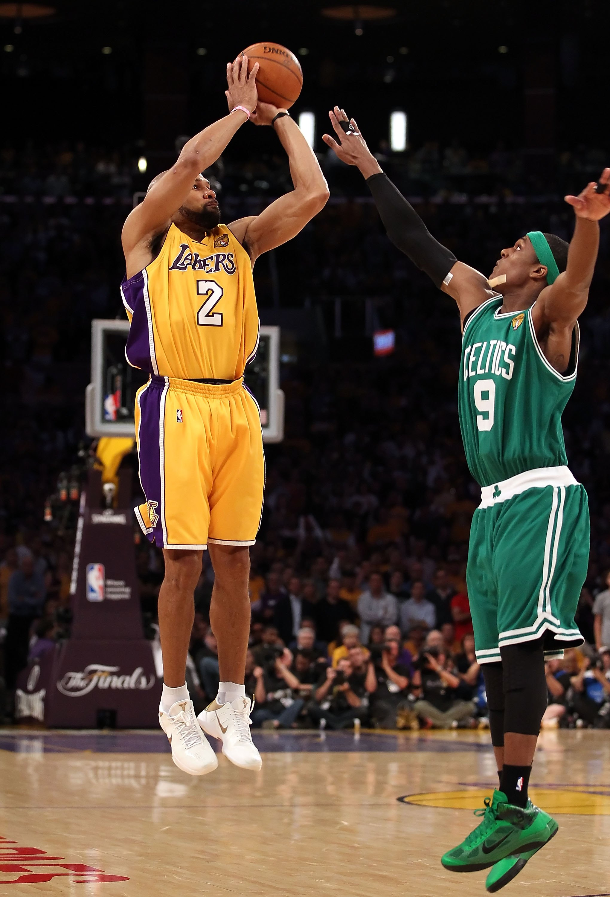 LOS ANGELES, CA - JUNE 17:  Derek Fisher #2 of the Los Angeles Lakers puts up a three point shot over Rajon Rondo #9 of the Boston Celtics in Game Seven of the 2010 NBA Finals at Staples Center on June 17, 2010 in Los Angeles, California.  The Lakers defe