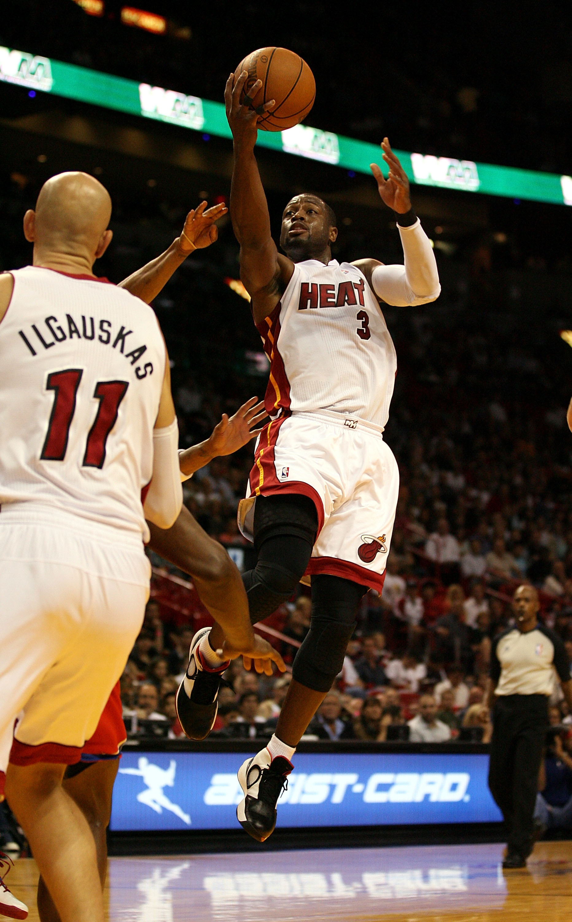 MIAMI - NOVEMBER 26:  Guard Dwyane Wade #3 of the Miami Heat shoots against the Philadelphia 76ers at American Airlines Arena on November 26, 2010 in Miami, Florida.  (Photo by Marc Serota/Getty Images)