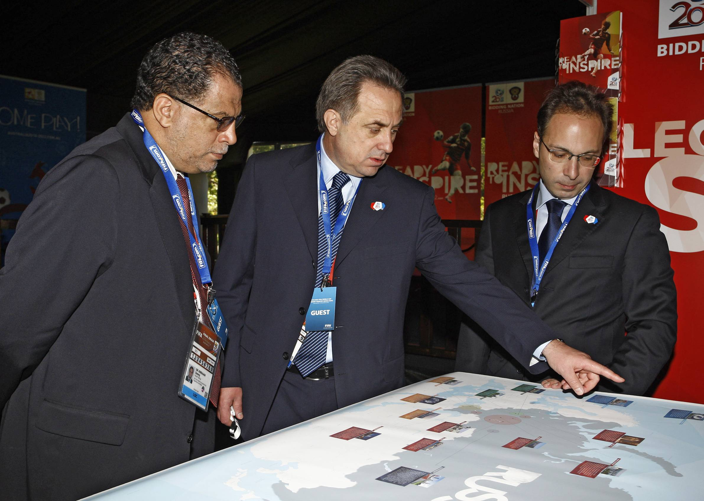 CAPE TOWN, SOUTH AFRICA - DECEMBER 4:  In this handout image provided by the 2010 FIFA World Cup Organising Committee South Africa, Vitaly Mutko (Russia Sports Minister) shows 2010 FIFA World Cup South OC CEO Danny Jordaan the Russian Bid Cities on a map