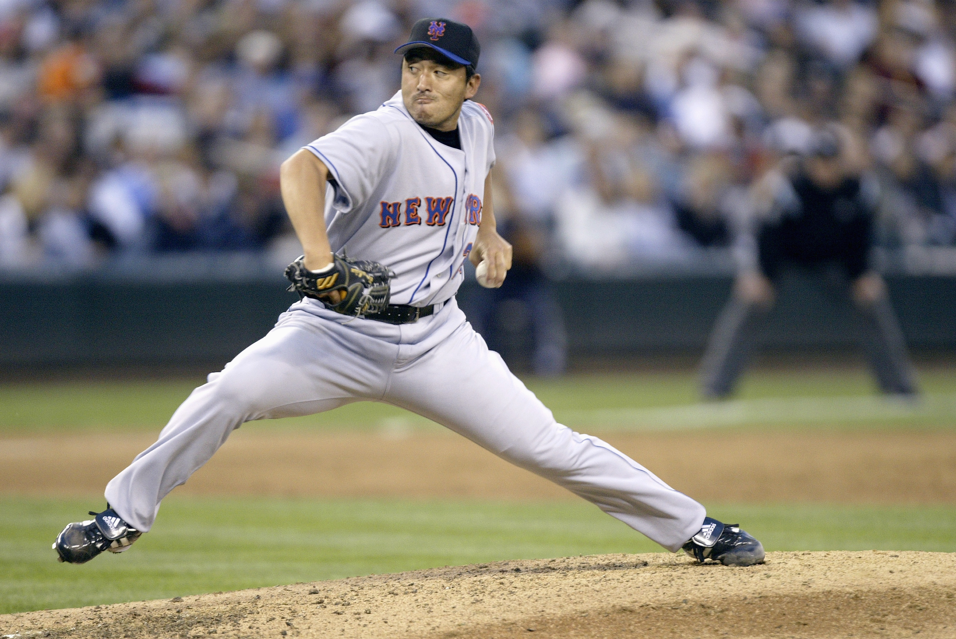 SEATTLE - JUNE 17:  Kazuhisa Ishii #25 of the New York Mets pitches during the game with the Seattle Mariners on June 17 2005 at Safeco Field in Seattle Washington. The Mariners won 5-0. (Photo by Otto Greule Jr/Getty Images)