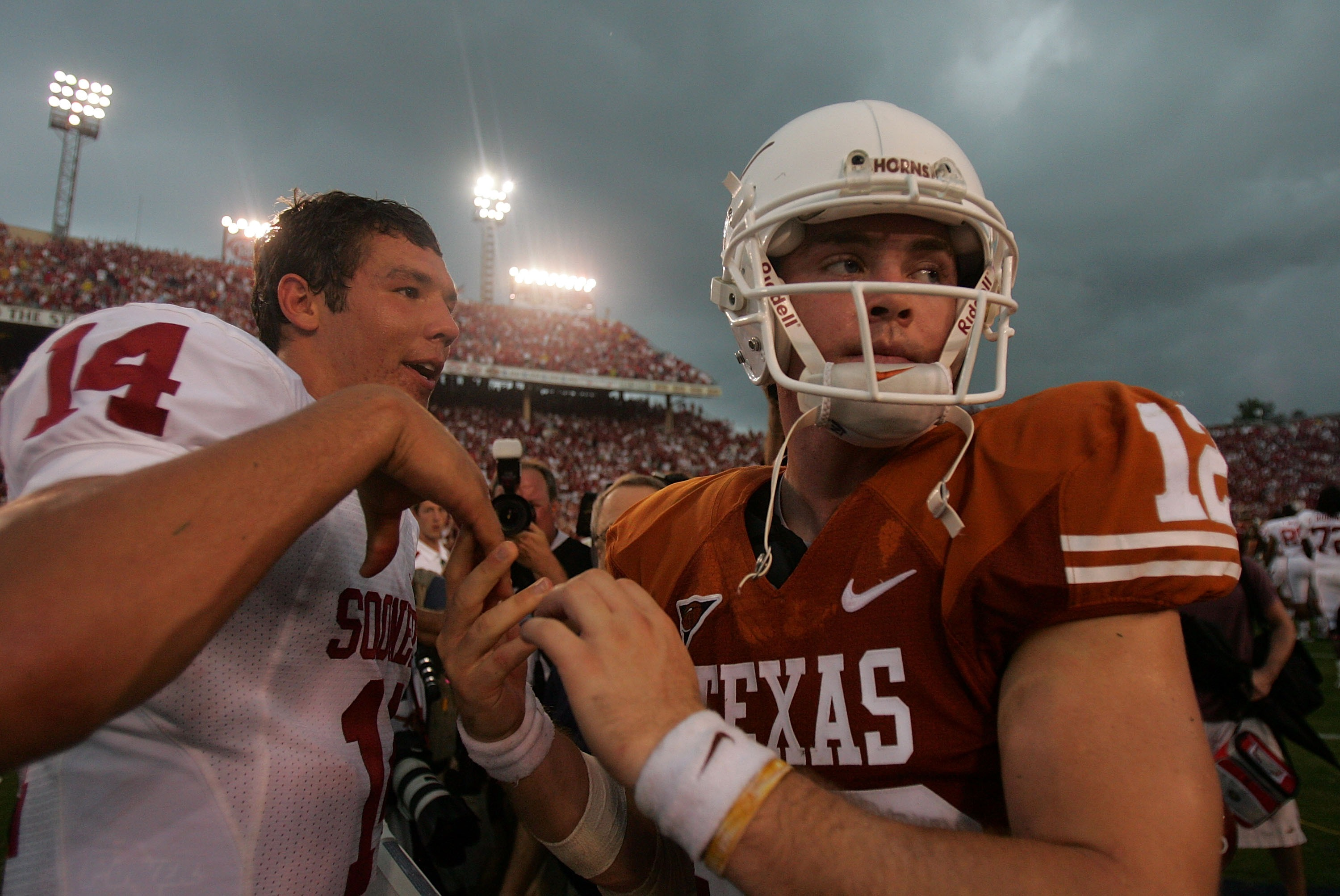 DALLAS - OCTOBER 6:  Quarterback Sam Bradford #14 of the Oklahoma Sooners and Colt McCoy of the Texas Longhorns after the Sooners defeated the Longhorns 28-21 at the Cotton Bowl October 6, 2007 in Dallas, Texas.  (Photo by Ronald Martinez/Getty Images)