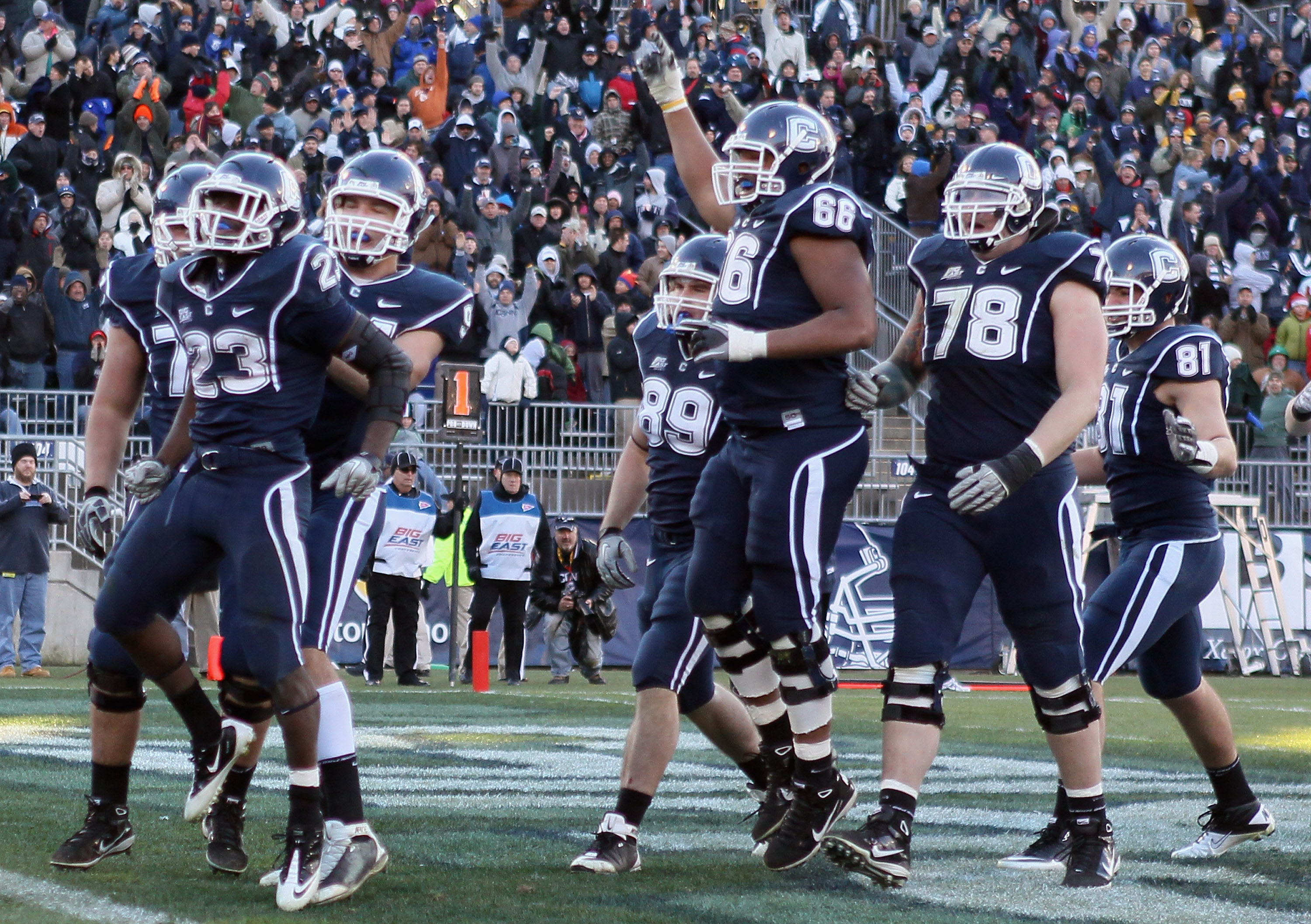 EAST HARTFORD, CT - NOVEMBER 27:  Jordan Todman #23 of the Connecticut Huskies celebrates his touchdown with teammates Ryan Griffin #94, Kevin Friend #77 and Mathieu Olivier #66 in the fourth quarter against the Cincinnati Bearcats on November 27, 2010 at