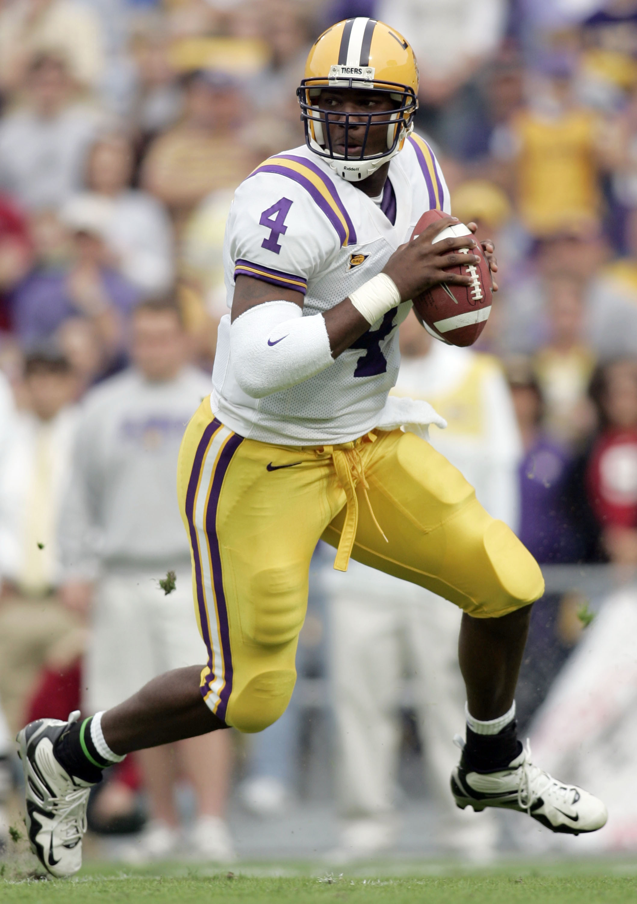 BATON ROUGE, LA - NOVEMBER 25:  Quarterback JaMarcus Russell #4 of the LSU Tigers scrambles against the Arkansas Razorbacks on November 25, 2005 at Tiger Stadium in Baton Rouge, Louisiana. LSU defeated Arkansas 19-17.  (Photo by Chris Graythen/Getty Image