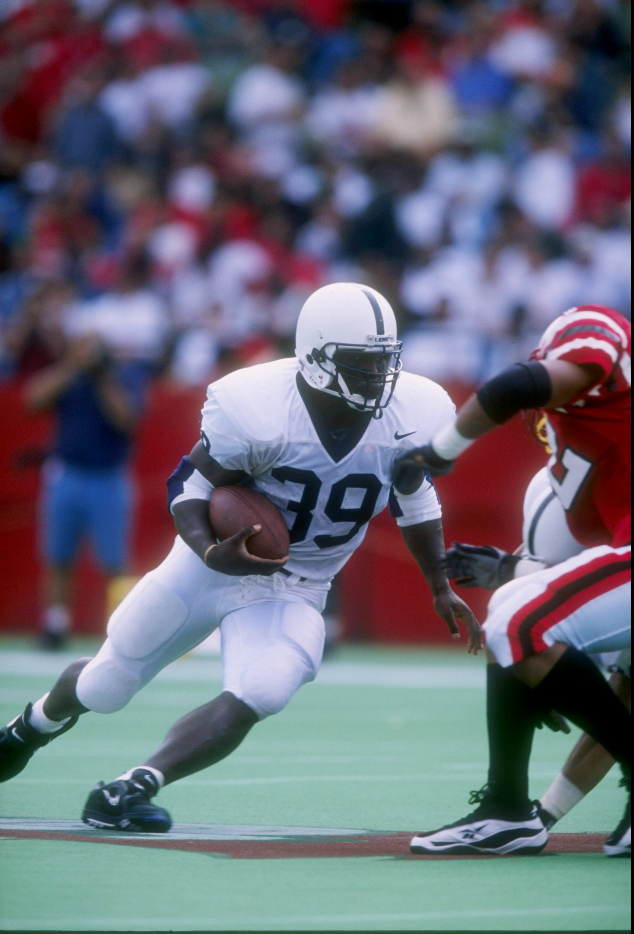 20 Sep 1997: Tailback Curtis Enis of the Penn State Nittany Lions runs down the field during a game against the Louisville Cardinals at Cardinal Stadium in Louisville, Kentucky. Penn State won the game 50-14