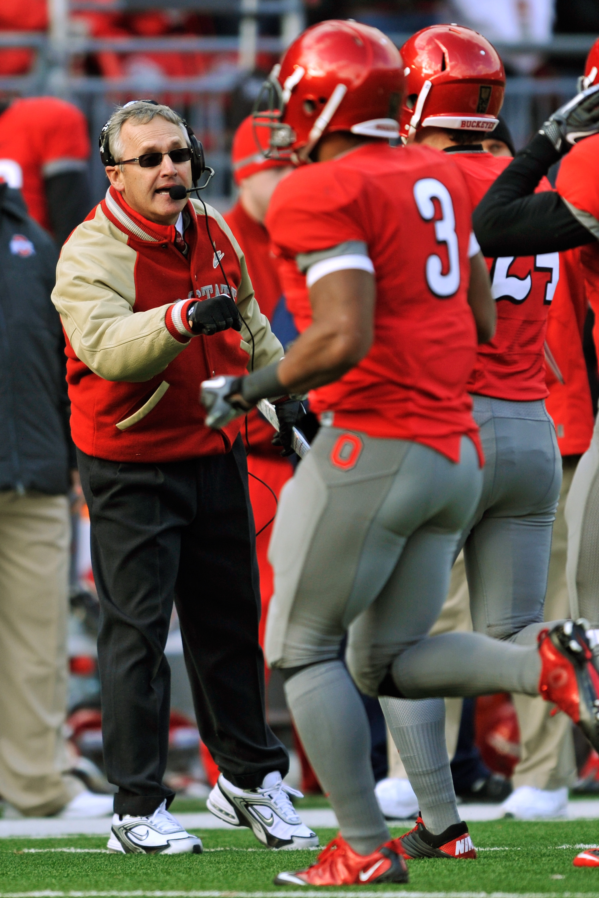 COLUMBUS, OH - NOVEMBER 27:  Head Coach Jim Tressel of the Ohio State Buckeyes fist bumps his players coming off the field during a game against the Michigan Wolverines at Ohio Stadium on November 27, 2010 in Columbus, Ohio. Ohio State defeated Michigan 3
