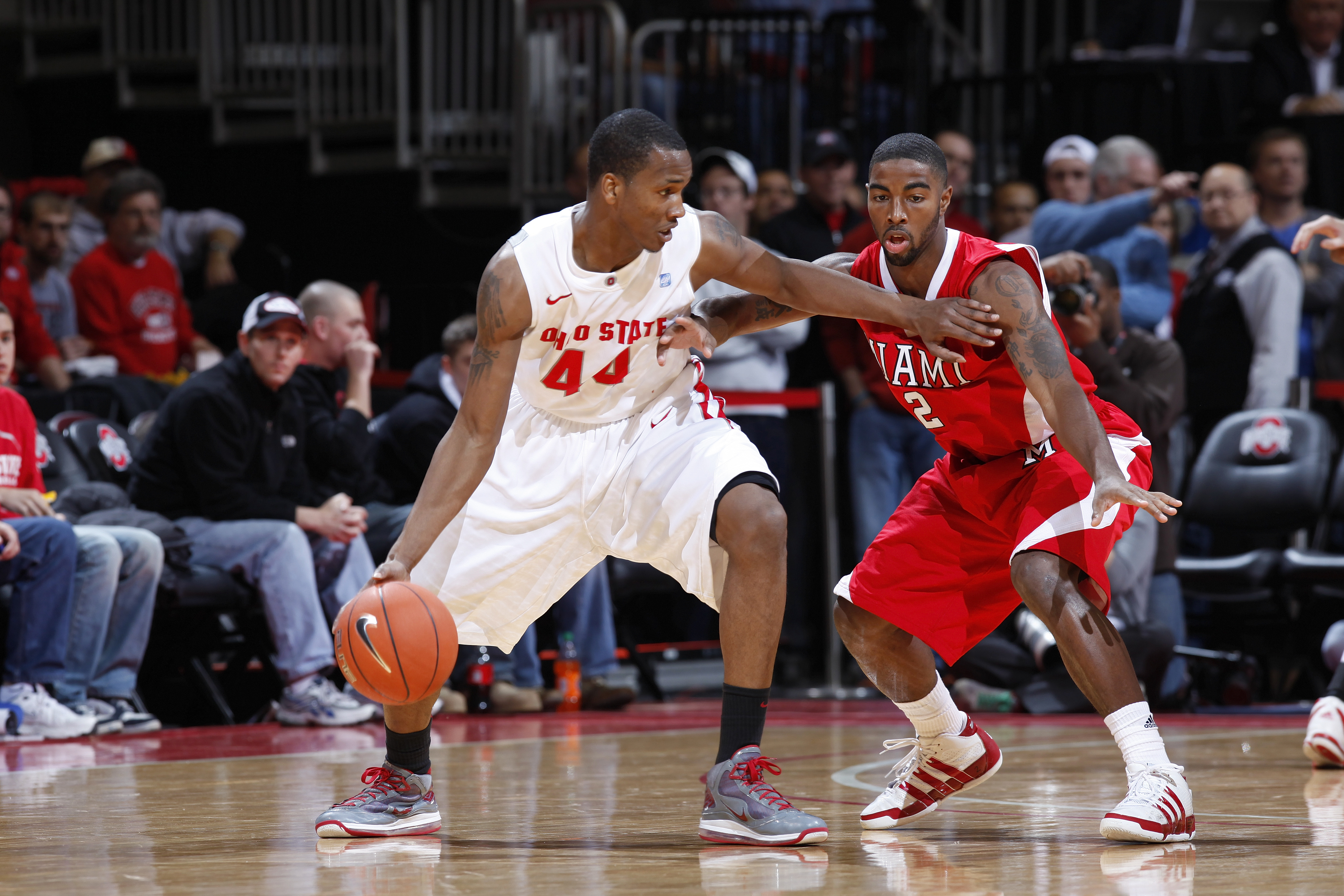 COLUMBUS, OH - NOVEMBER 26: William Buford #44 of the Ohio State Buckeyes tries to get to the basket against Quinten Rollins #2 of the Miami RedHawks at Value City Arena on November 26, 2010 in Columbus, Ohio. Ohio State won 66-45. (Photo by Joe Robbins/G
