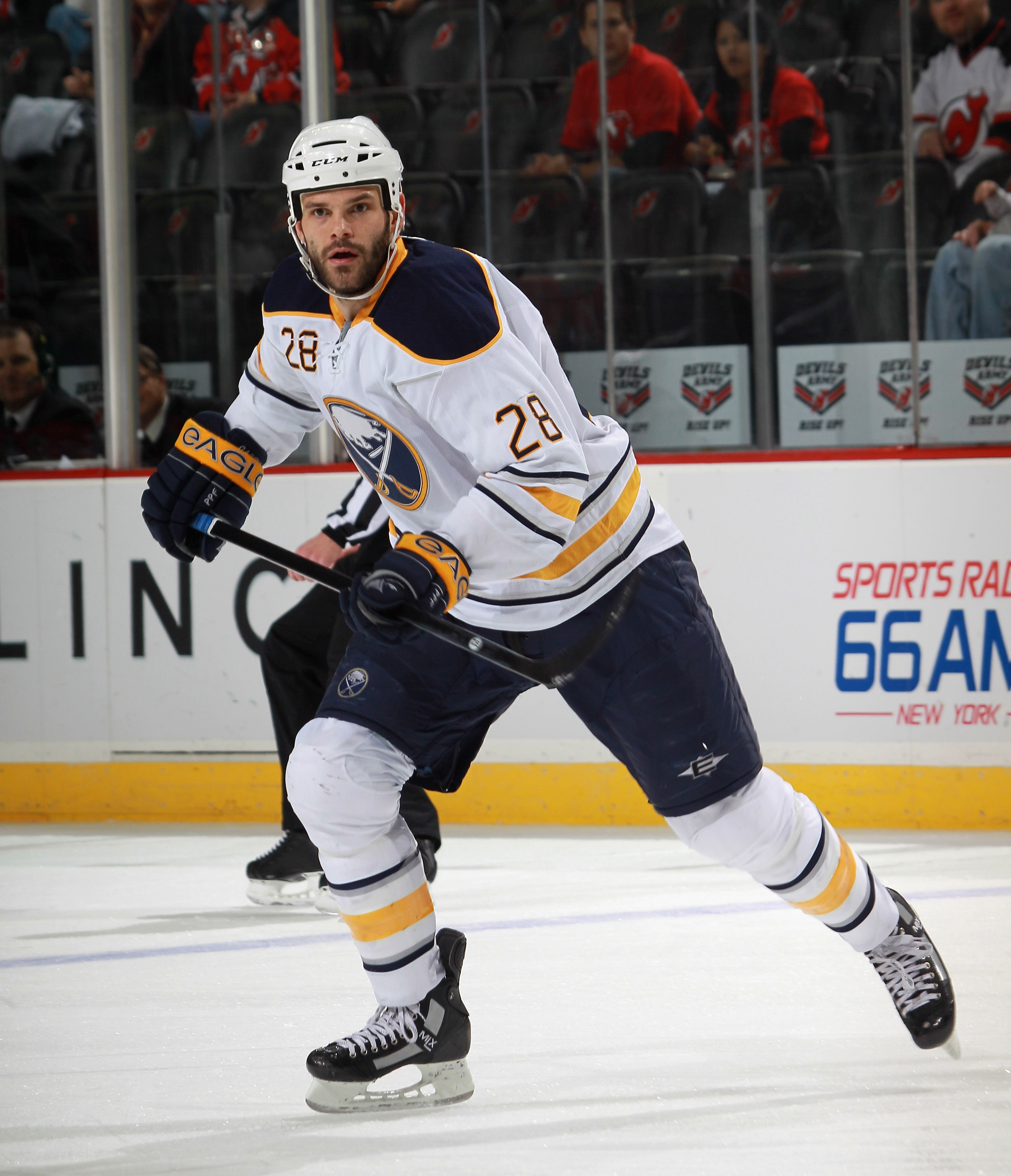 NEWARK, NJ - NOVEMBER 10: Paul Gaustad #28 of the Buffalo Sabres skates against the New Jersey Devils at the Prudential Center on November 10, 2010 in Newark, New Jersey. The Sabres defeated the DSevils 5-4 in the shootout.  (Photo by Bruce Bennett/Getty