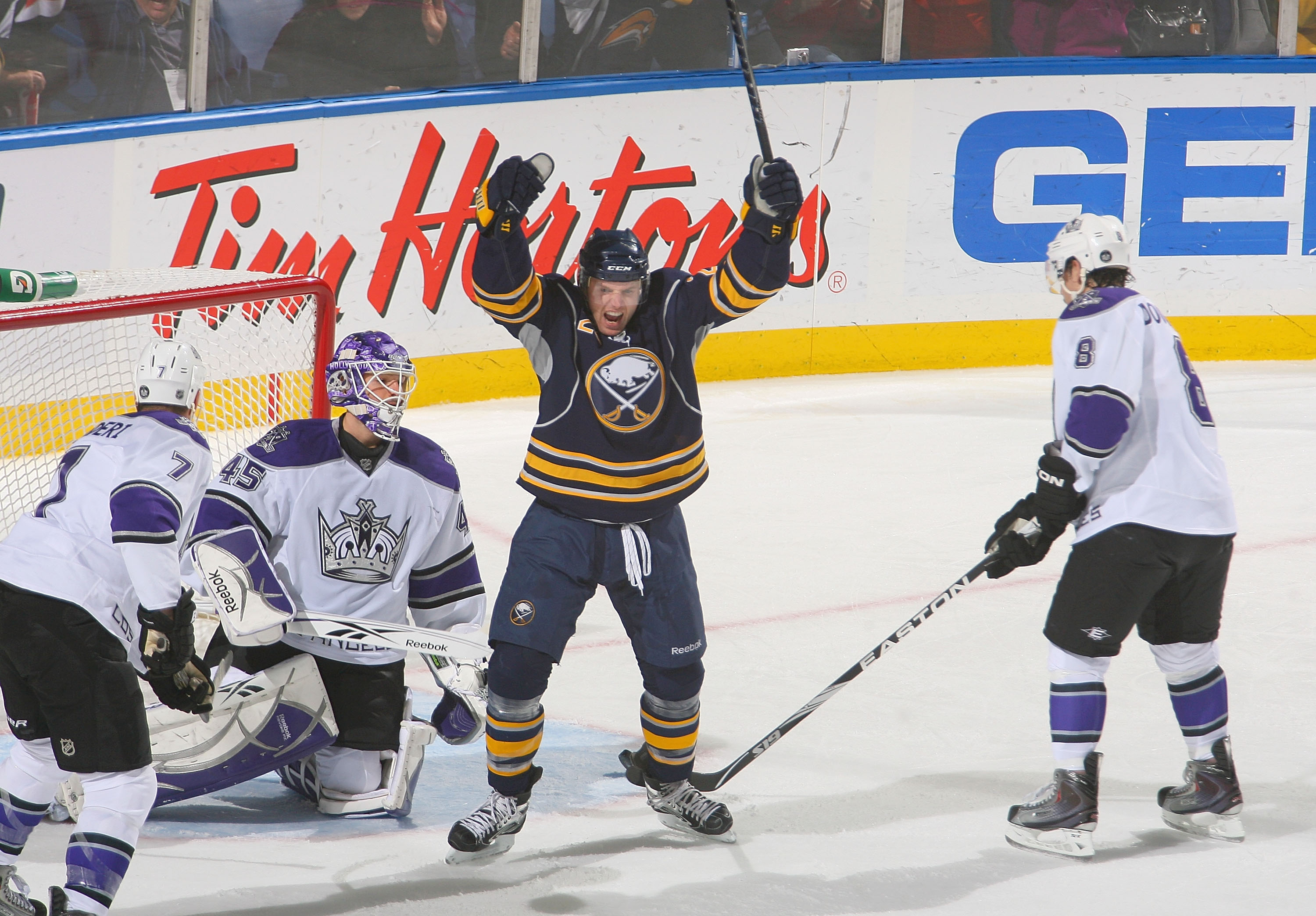 BUFFALO, NY - NOVEMBER 19: Thomas Vanek #26 of the Buffalo Sabres celebrates a goal by teammate Derek Roy #9 (not shown) against Rob Scuderi #7, Jonathan Bernier #45 and Drew Doughty #8 of the Los Angeles Kings at HSBC Arena on November 19, 2010 in Buffal