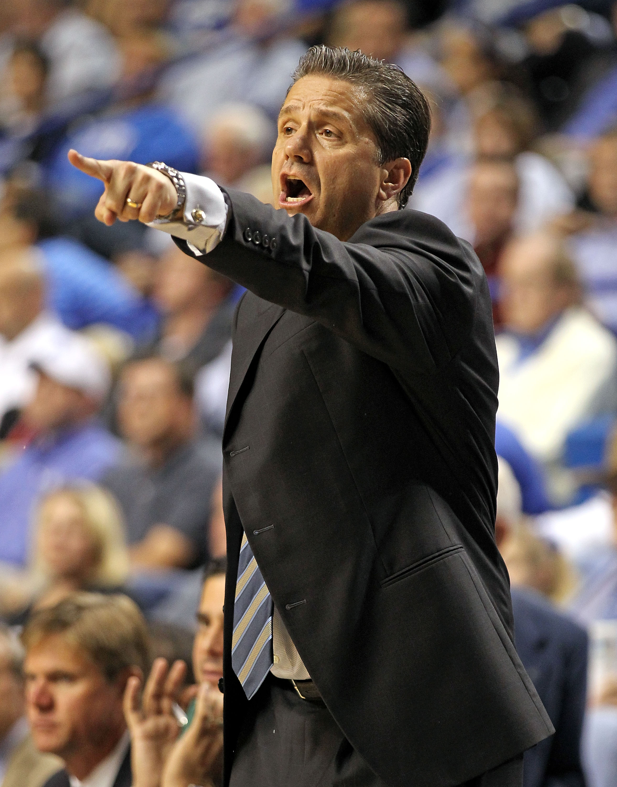 LEXINGTON, KY - NOVEMBER 12:  John Calipari the Head Coach of the Kentucky Wildcats gives   instructions to his team during the game against East Tennessee State Buccaneers at Rupp Arena on November 12, 2010 in Lexington, Kentucky.  (Photo by Andy Lyons/G