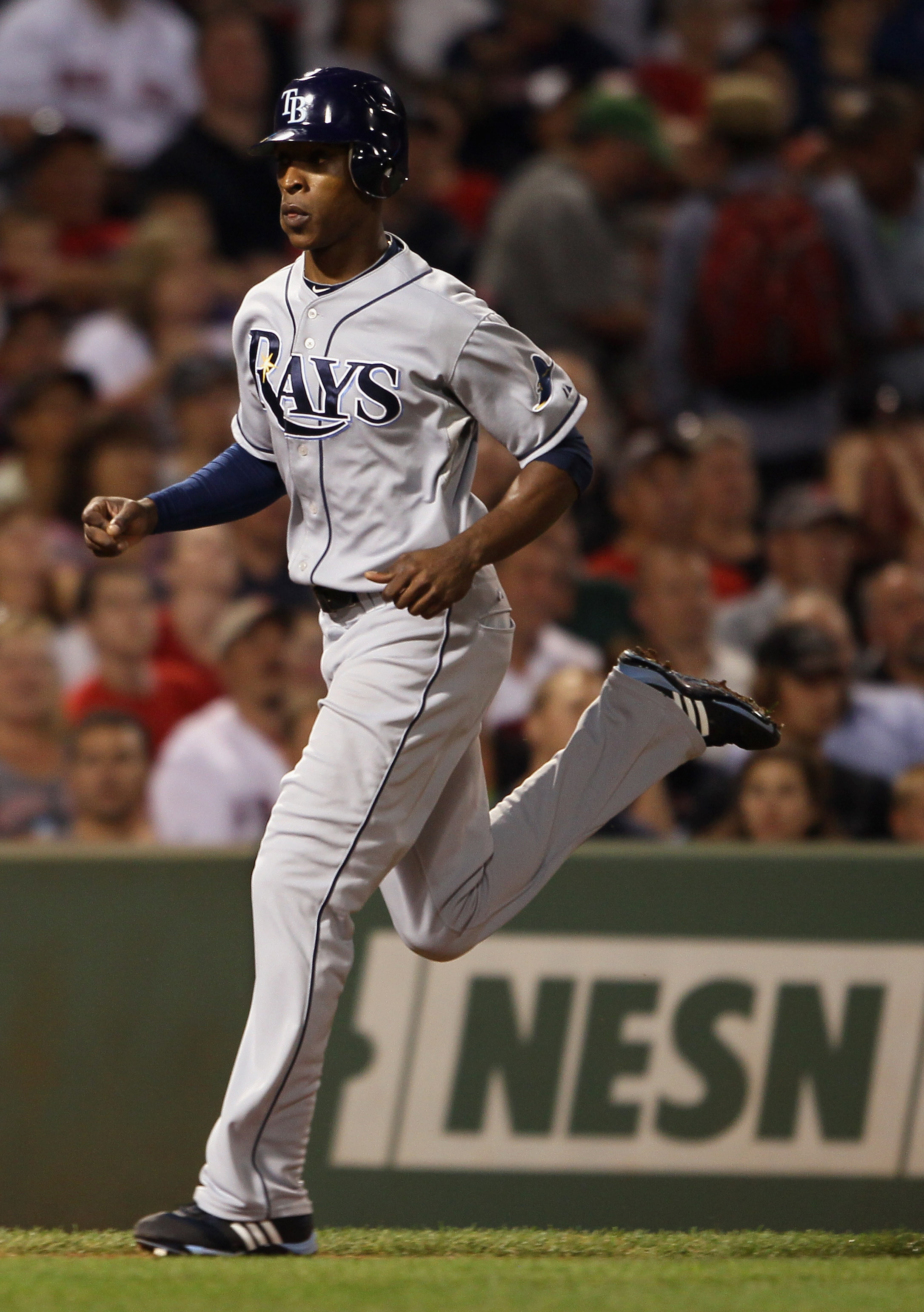 BOSTON - SEPTEMBER 07:  B.J. Upton #2 of the Tampa Bay Rays scores a run in the fourth inning against the Boston Red Sox on September 7, 2010 at Fenway Park in Boston, Massachusetts.  (Photo by Elsa/Getty Images)