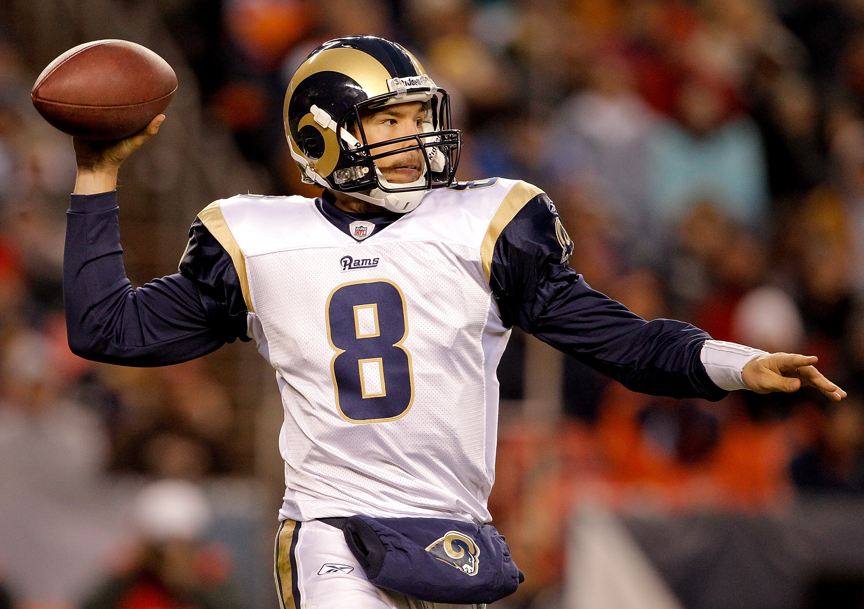 DENVER - NOVEMBER 28:  Quarterback Sam Bradford #8 of the St. Louis Rams makes a pass during the third quarter against the Denver Broncos at INVESCO Field at Mile High on November 28, 2010 in Denver, Colorado. The Rams defeated the Broncos 36-33. (Photo b