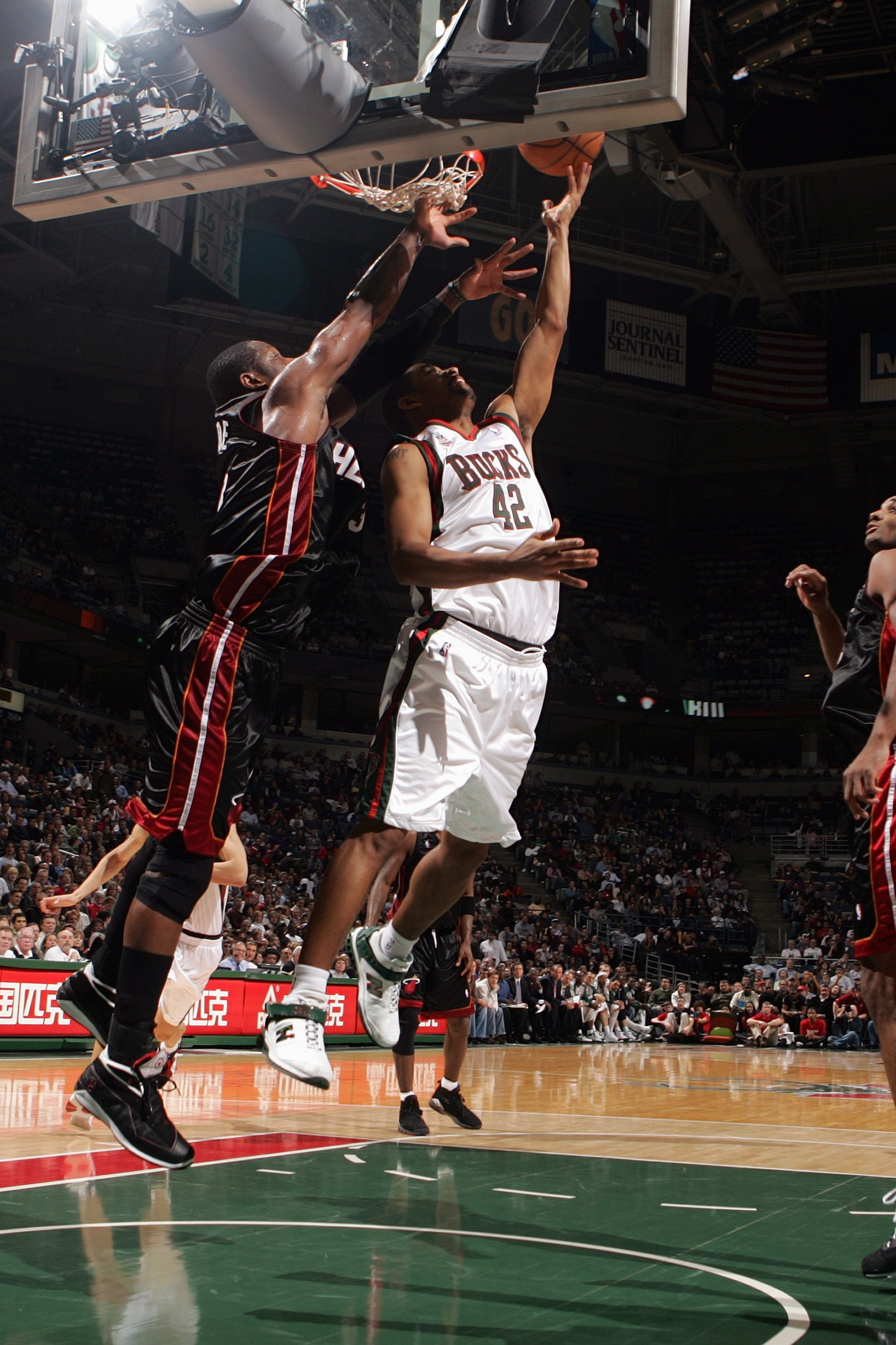 MILWAUKEE - JANUARY 9:  Charlie Bell #42 of the Milwaukee Bucks lays up a shot against Dwyane Wade #3 of the Miami Heat during the game at the Bradley Center on January 9, 2008 in Milwaukee, Wisconsin.  The Bucks won 98-92.  NOTE TO USER: User expressly a