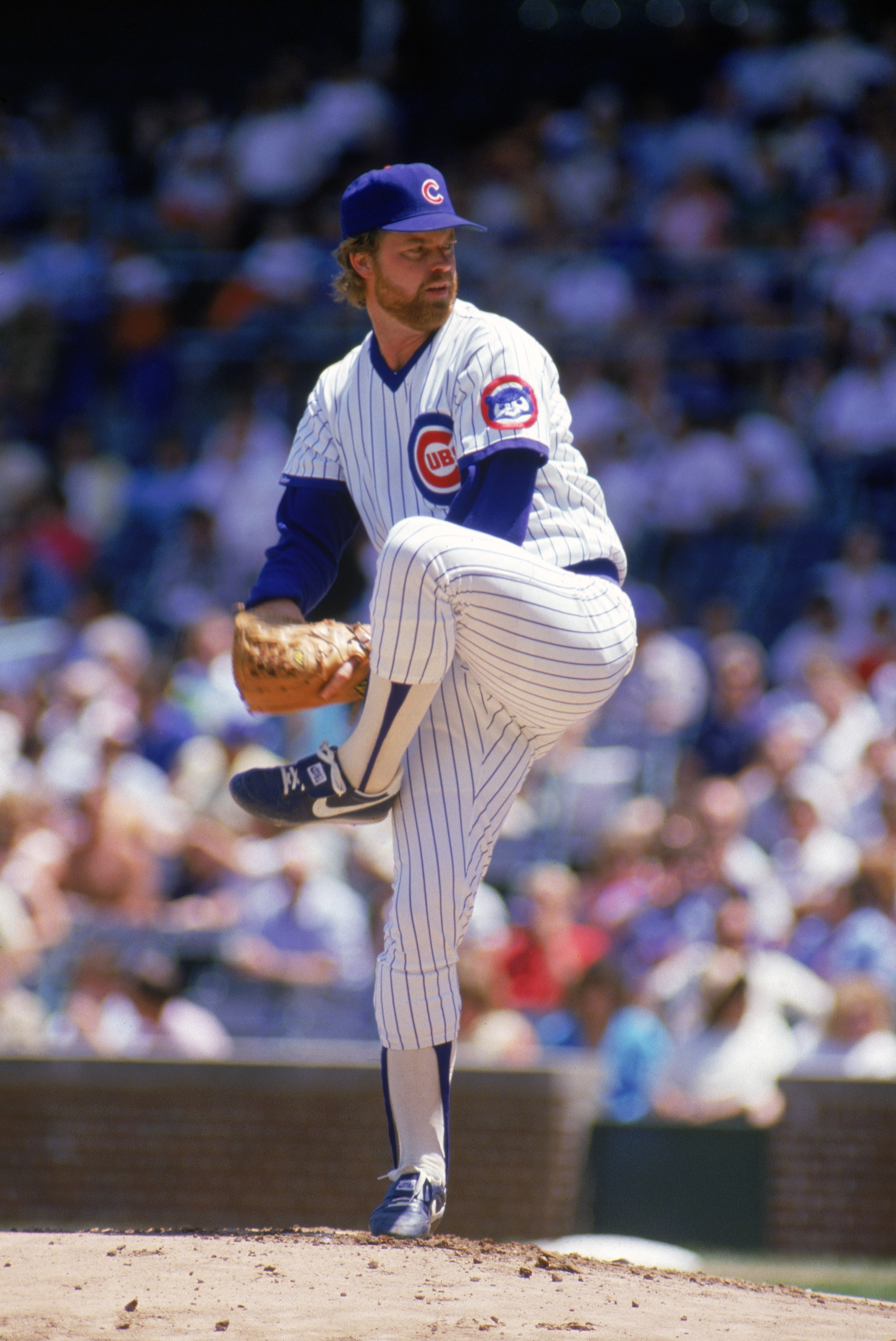 CHICAGO - 1987:  Rick Sutcliffe #40 of the Chicago Cubs winds back to pitch during a game in the 1987 season at Wrigley Field in Chicago, Illinois . ( Photo by: Jonathan Daniel/ Getty Images )