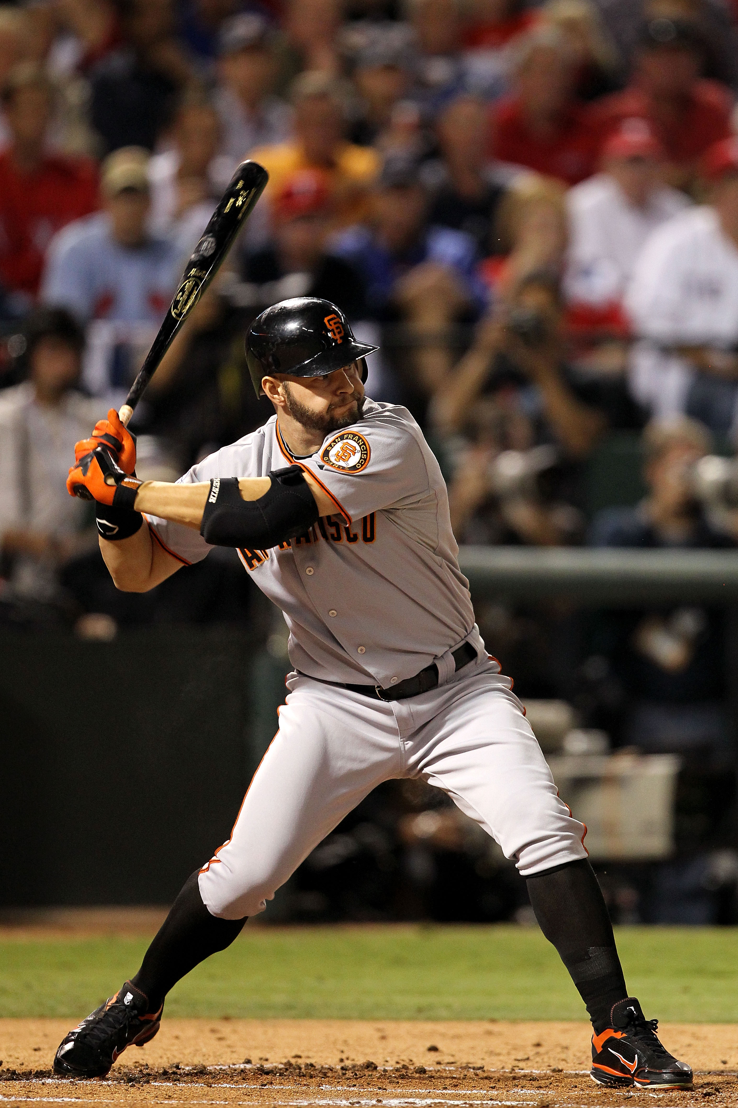 ARLINGTON, TX - NOVEMBER 01:  Cody Ross #13 of  the San Francisco Giants bats against the Texas Rangers in Game Five of the 2010 MLB World Series at Rangers Ballpark in Arlington on November 1, 2010 in Arlington, Texas. The Giants won 3-1.  (Photo by Rona