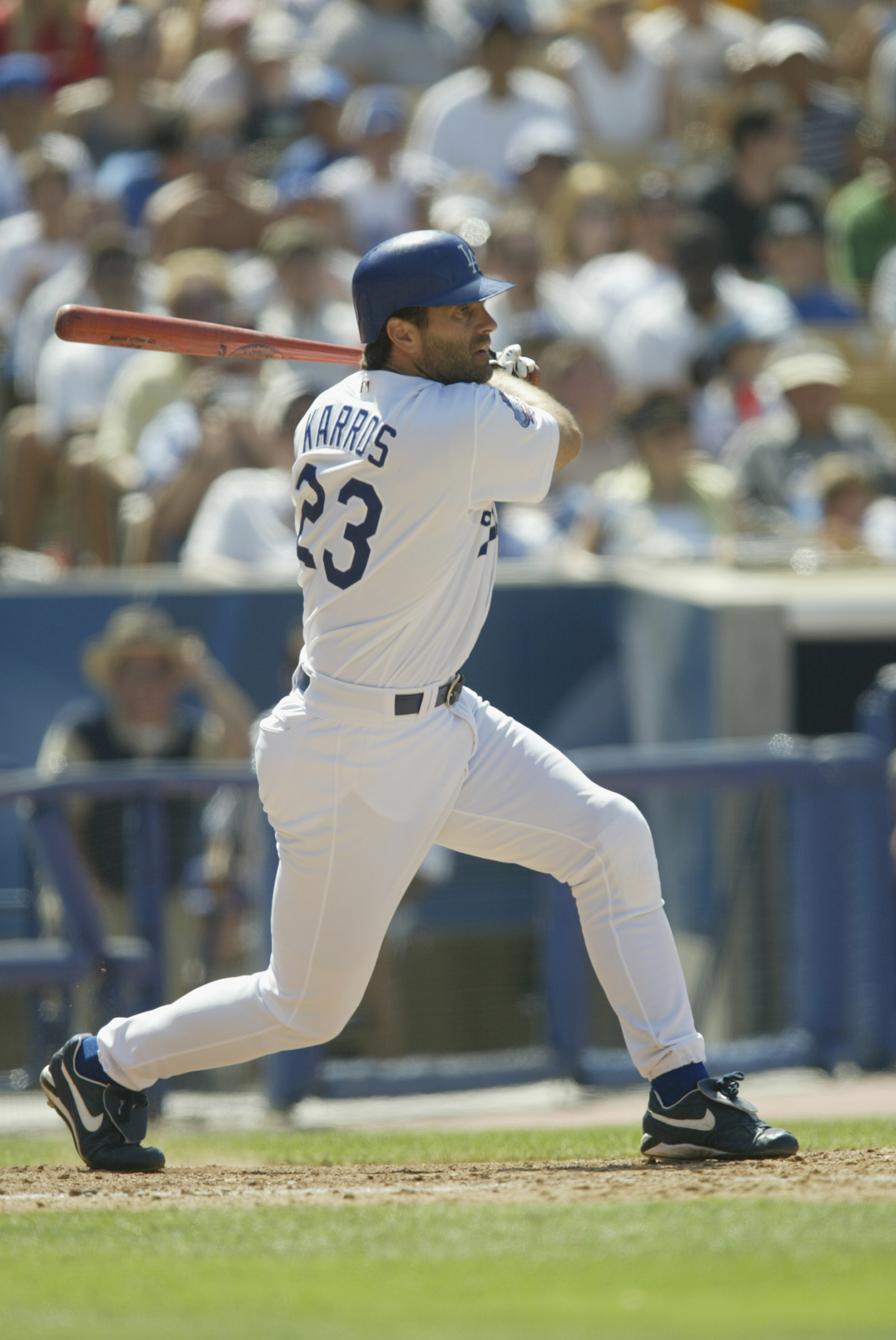 LOS ANGELES - JULY 20:  First Baseman Eric Karros #23 of the Los Angeles Dodgers fouls off a pitch from Felix Rodriguez of the San Francisco Giants in the seventh inning of the MLB game on July 20, 2002 at Dodger Stadium in Los Angeles, California. The Do