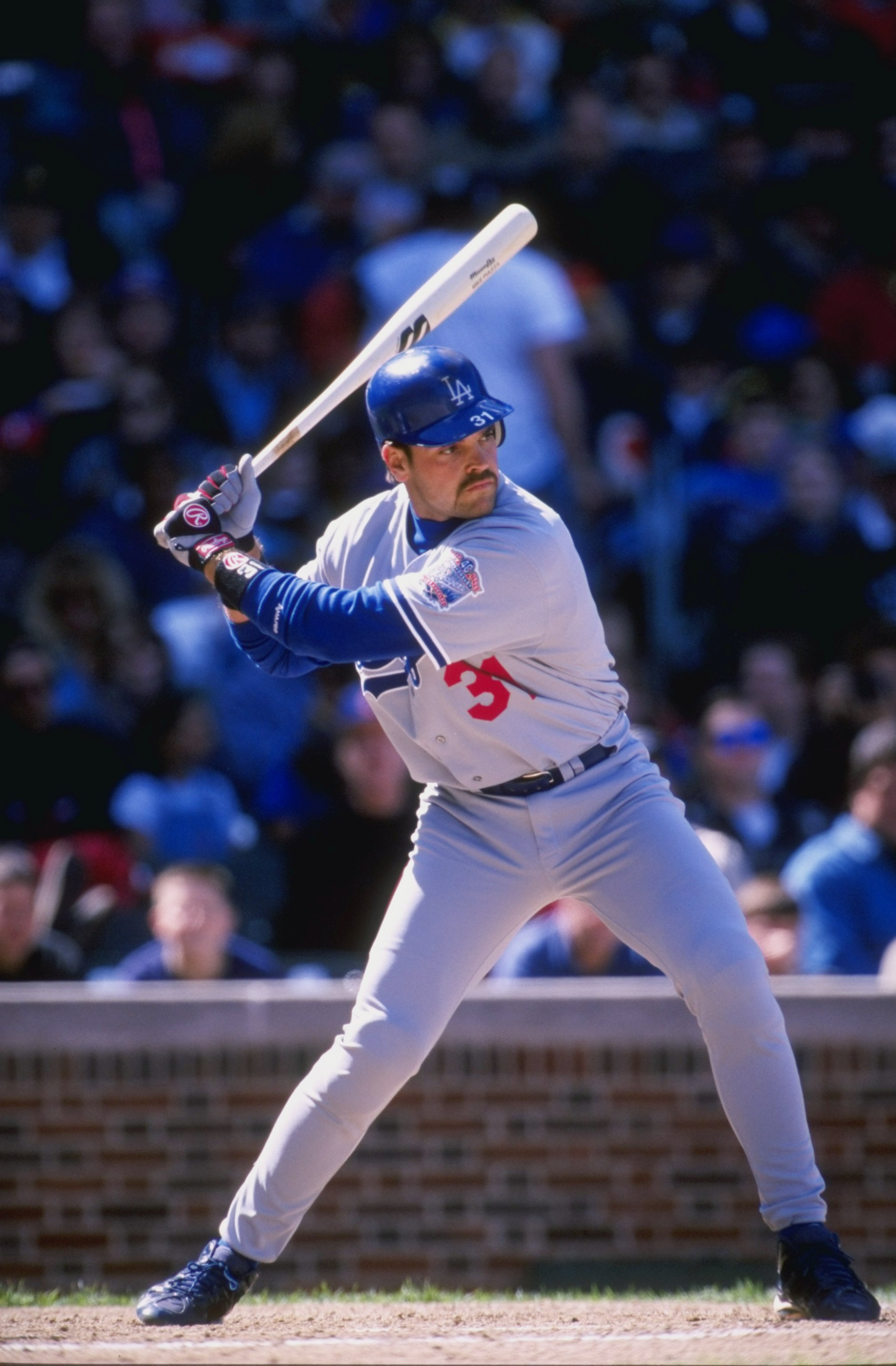 17 Apr 1998:  Catcher Mike Piazza of the Los Angeles Dodgers in action during a game against the Chicago Cubs at Wrigley Field in Chicago, Illinois. The Dodgers defeated the Cubs 10-3. Mandatory Credit: Harry How  /Allsport