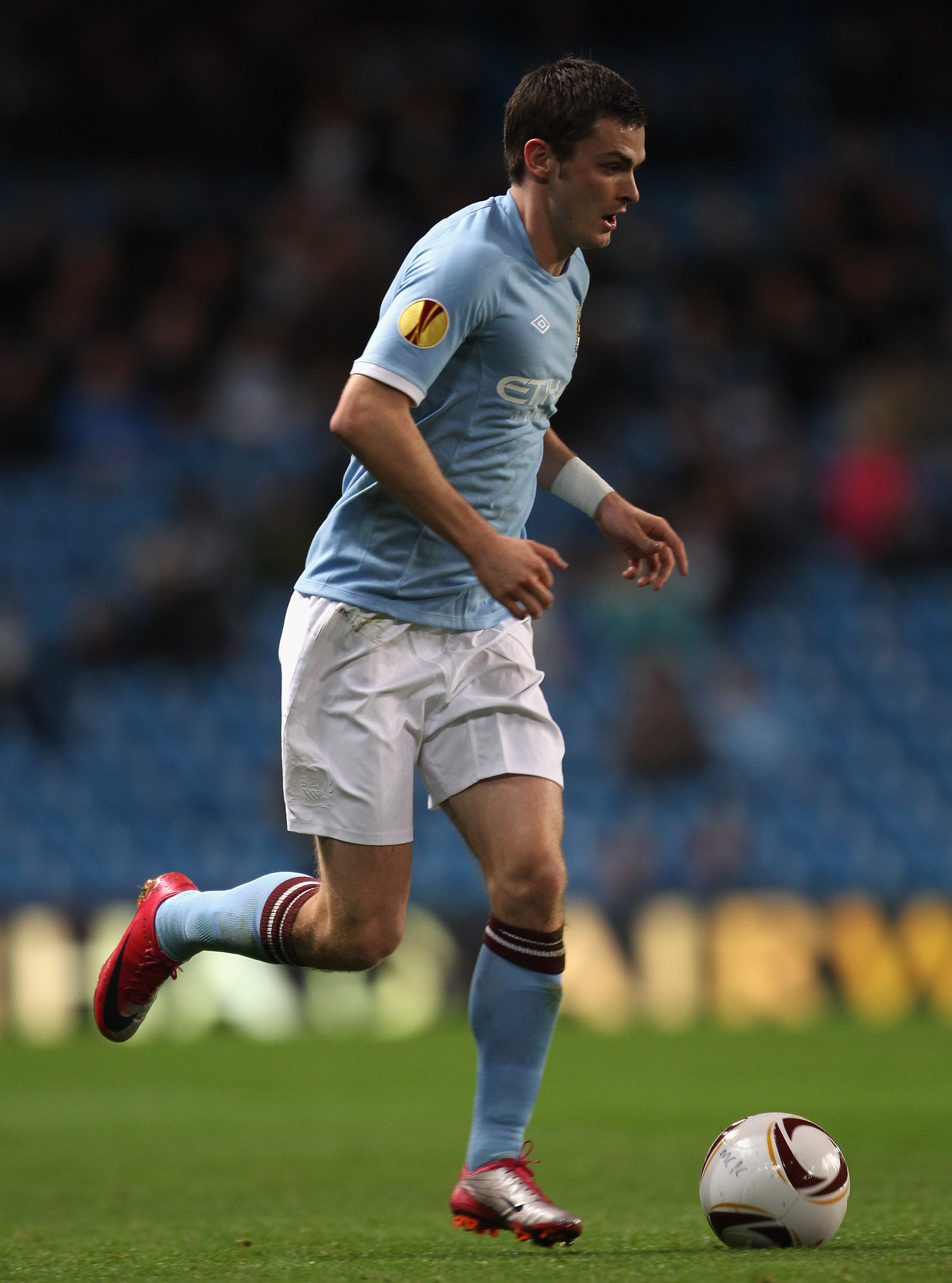 MANCHESTER, ENGLAND - OCTOBER 21:  Adam Johnson of Manchester City runs with the ball during the UEFA Europa League Group A match between Manchester City and KKS Lech Poznan at City of Manchester Stadium on October 21, 2010 in Manchester, England.  (Photo