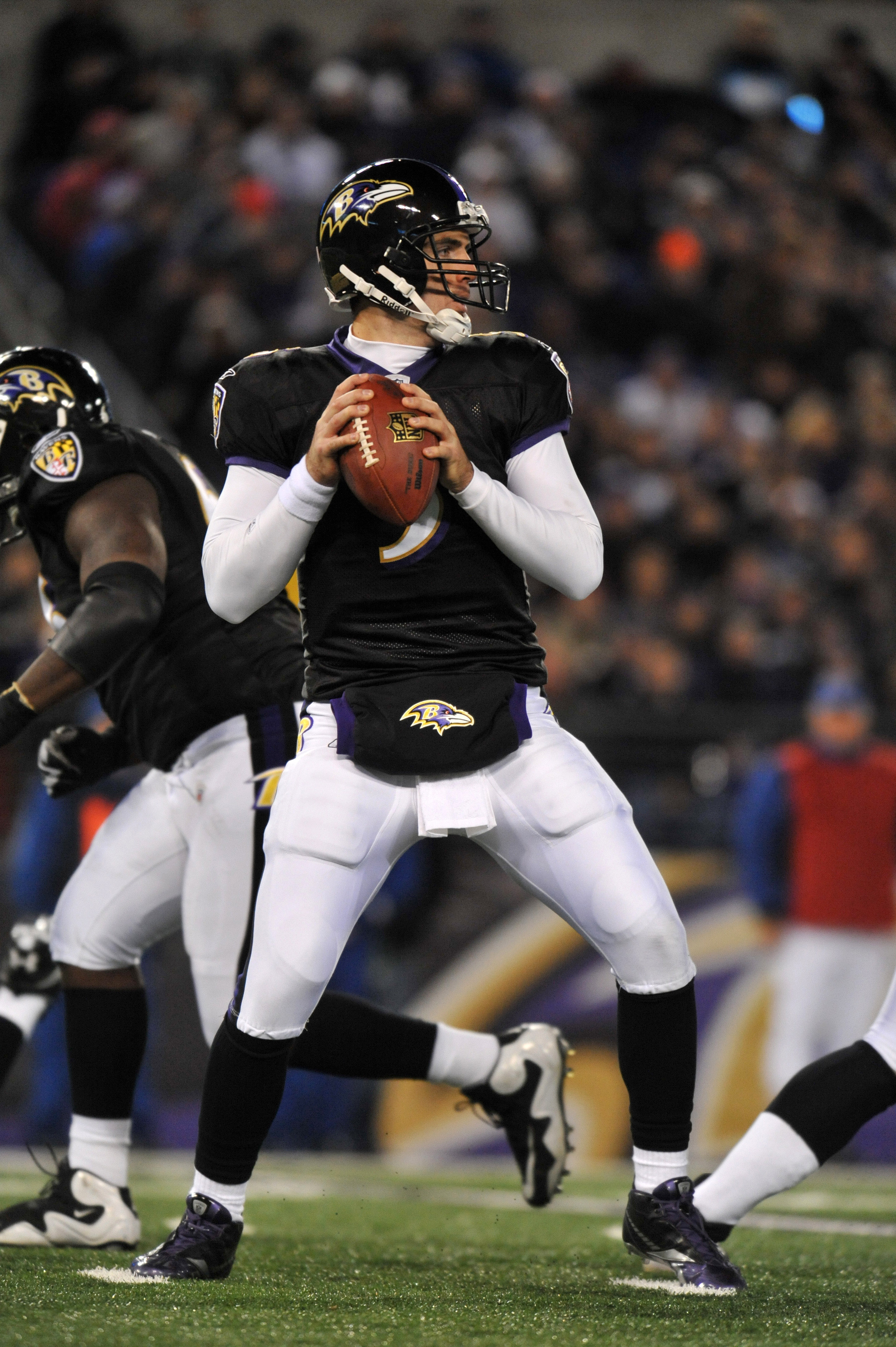 BALTIMORE, MD - NOVEMBER 28:  Joe Flacco #5 of the Baltimore Ravens passes against the Tampa Bay Buccaneers at M&T Bank Stadium on November 28, 2010 in Baltimore, Maryland. The Ravens lead the Buccaneers at the half 17-3. (Photo by Larry French/Getty Imag