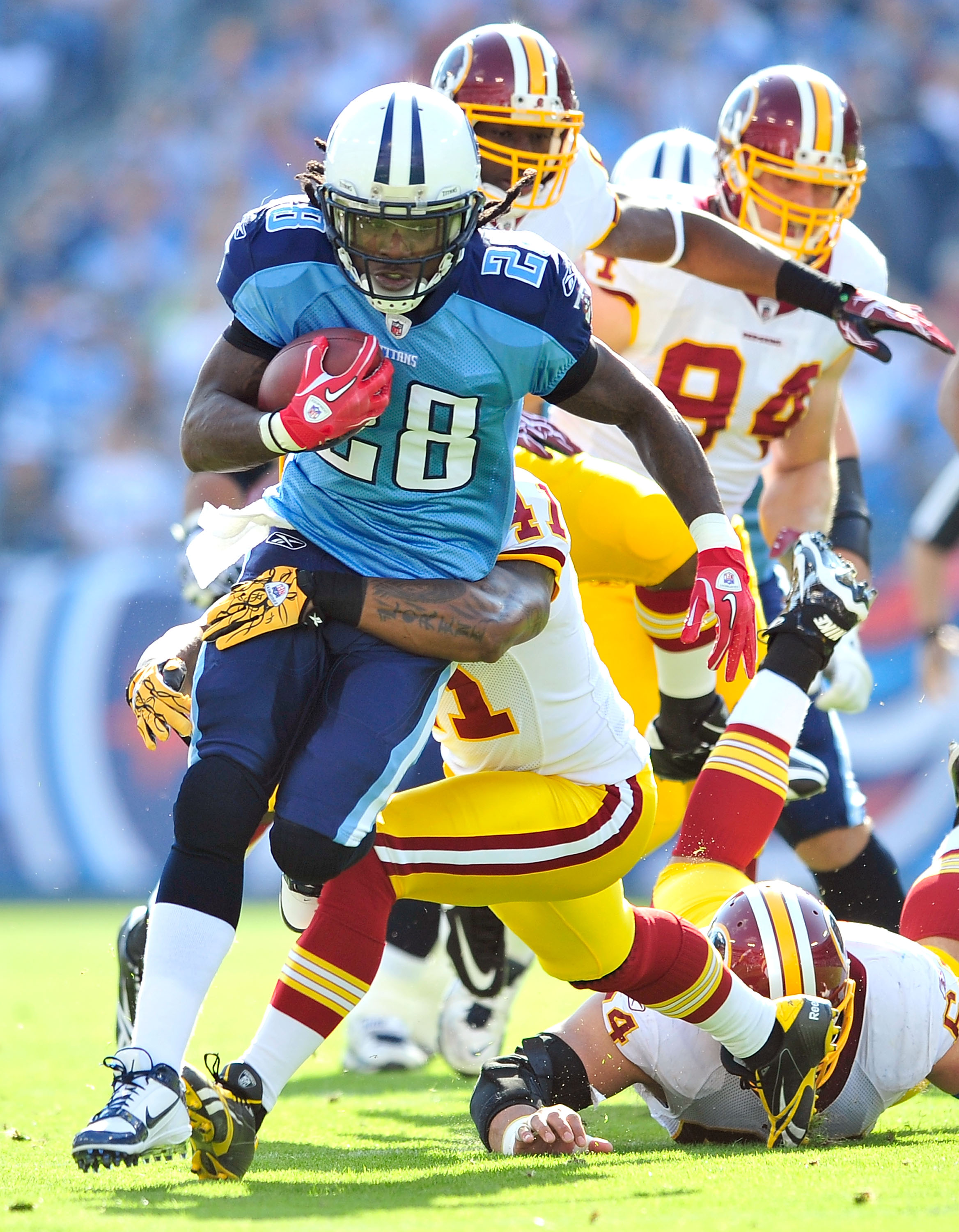 NASHVILLE, TN - NOVEMBER 21:  Kareem Moore #41 of the Washington Redskins tackles Chris Johnson #28 of the Tennessee Titans during the first half at LP Field on November 21, 2010 in Nashville, Tennessee.  (Photo by Grant Halverson/Getty Images)