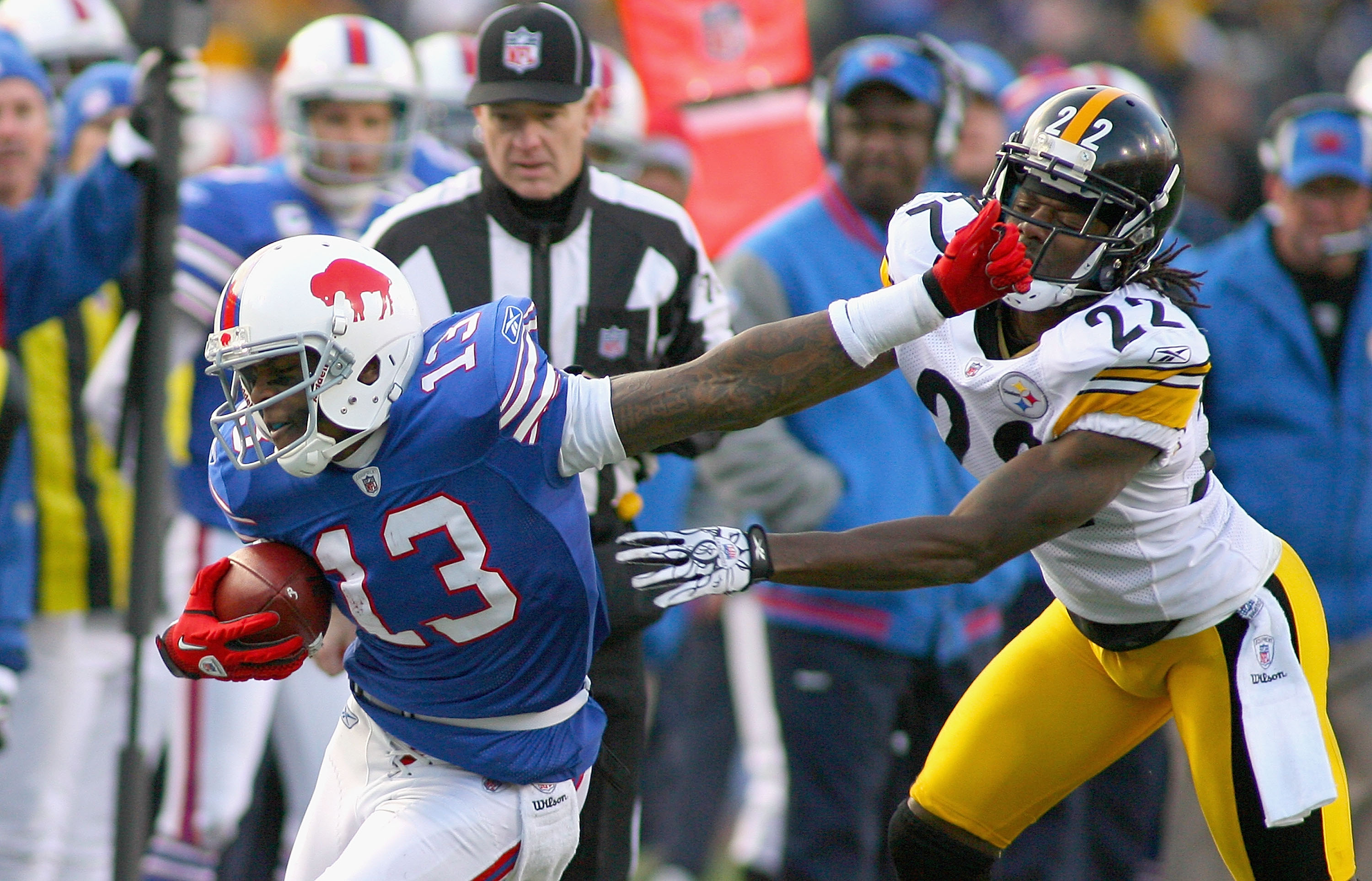 ORCHARD PARK, NY - NOVEMBER 28:  Steve Johnson #13 of the Buffalo Bills is pushed out of bounds by William Gay #22 of the Pittsburgh Steelers at Ralph Wilson Stadium at Ralph Wilson Stadium on November 28, 2010 in Orchard Park, New York. Pittsburgh won 19