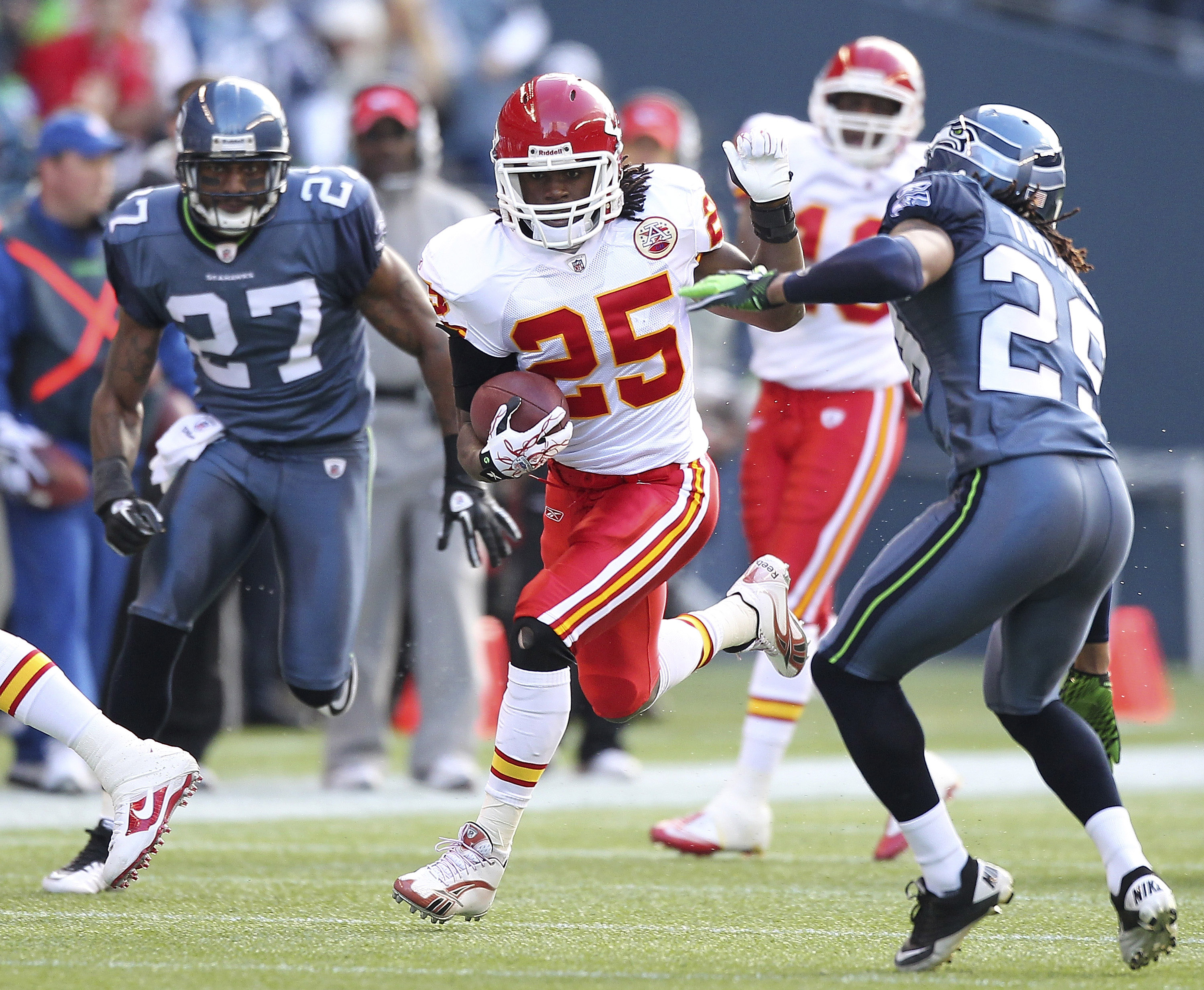 SEATTLE - NOVEMBER 28:  Running back Jamaal Charles #25 of the Kansas City Chiefs rushes against Earl Thomas #29 of the Seattle Seahawks at Qwest Field on November 28, 2010 in Seattle, Washington. The Chiefs defeated the Seahawks 42-24. (Photo by Otto Gre