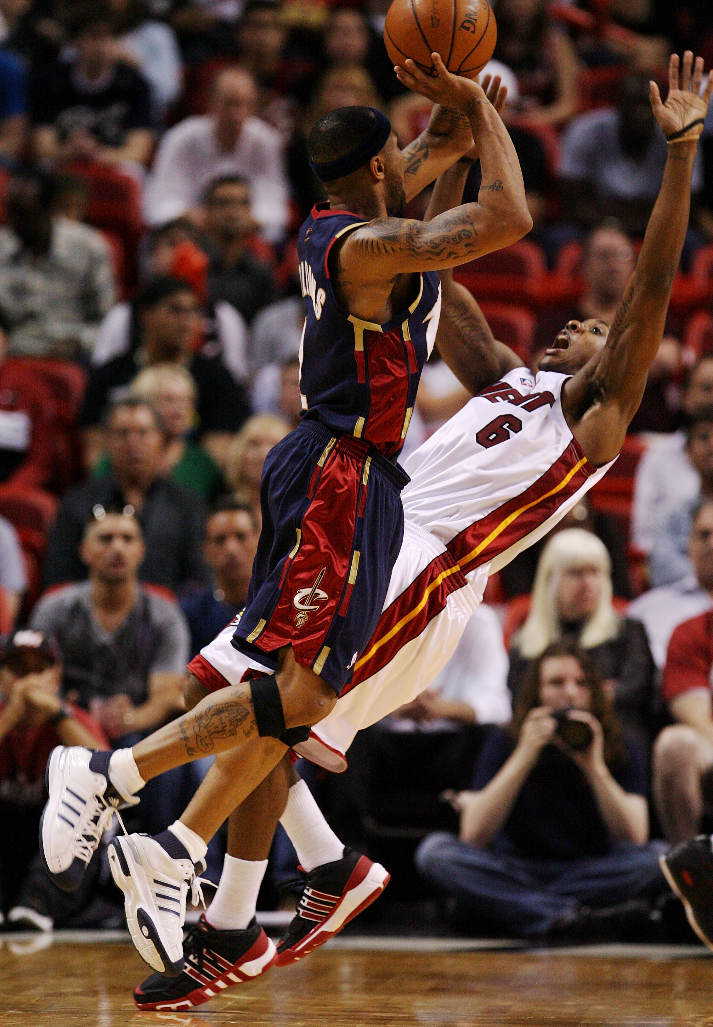 MIAMI - DECEMBER 30:  Mario Chalmers #6 of the Miami Heat draws an offensive foul on Mo Williams #2 of the Cleveland Cavaliers at American Airlines Arena on December 30, 2008 in Miami, Florida. The Heat defeated the Cavaliers 104-95. NOTE TO USER: User ex