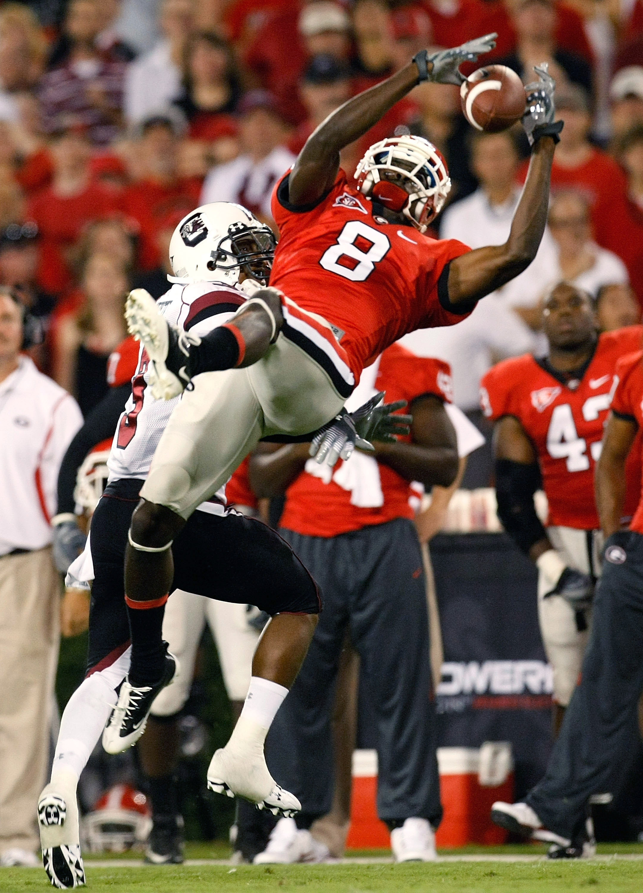 ATHENS, GA - SEPTEMBER 12:  A.J. Green #8 of the Georgia Bulldogs pulls in this reception against Akeem Auguste #3 of the South Carolina Gamecocks at Sanford Stadium on September 12, 2009 in Athens, Georgia.  (Photo by Kevin C. Cox/Getty Images)