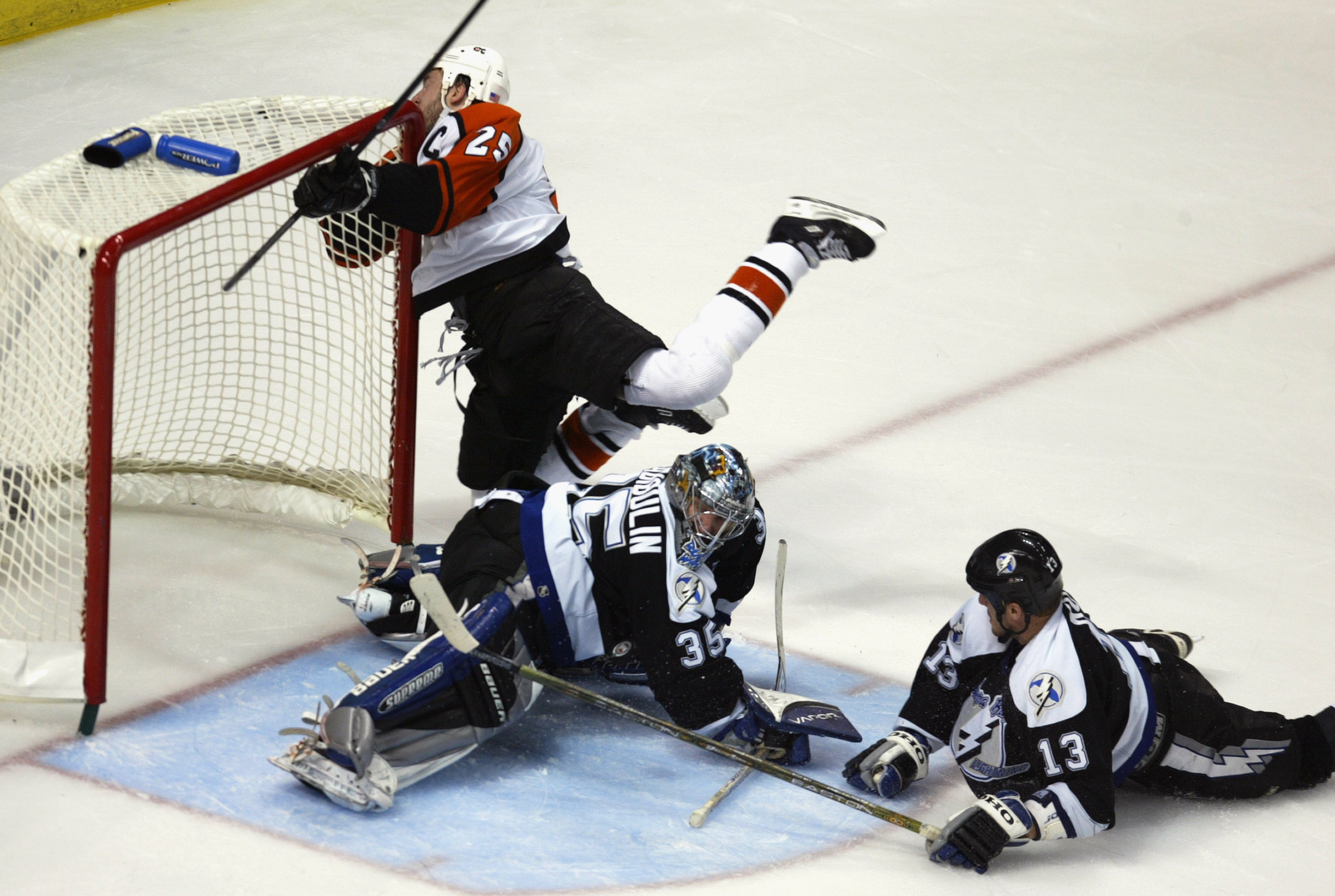 TAMPA, FL - MAY 22:  Keith Primeau #25 of the Philadelphia Flyers crashes the net as goaltender Nikolai Khabibulin #35 and Pavel Kubina #13 of the Tampa Bay Lightning keep the puck out of the net during Game Seven of the NHL Eastern Conference Finals on M