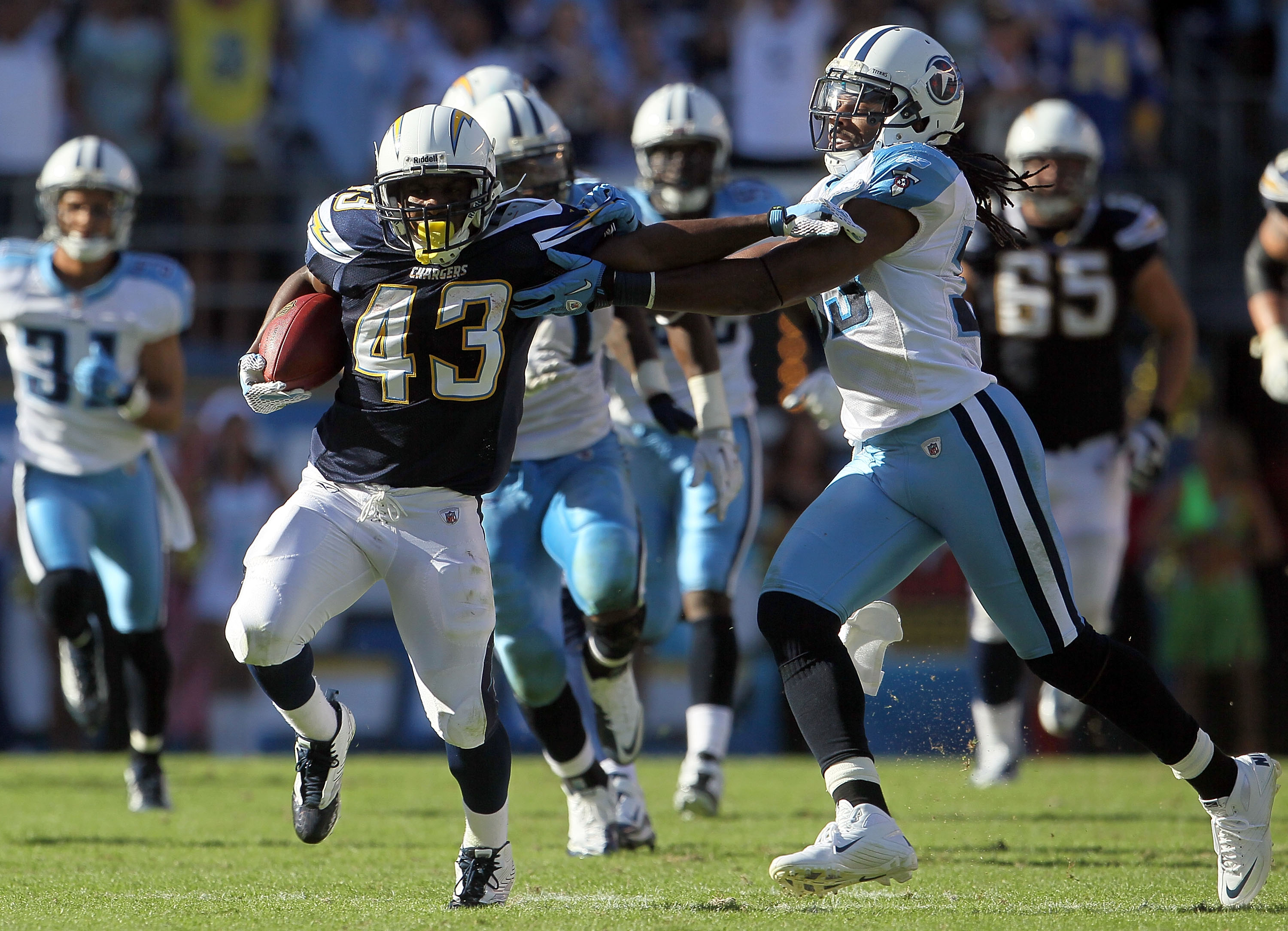 SAN DIEGO - OCTOBER 31:  Running back Darren Sproles #43 of the San Diego Chargers is pursued by Michael Griffin #33 of the Tennessee Titans in the game at Qualcomm Stadium on October 31, 2010 in San Diego, California. The Chargers defeated the Titans 33-